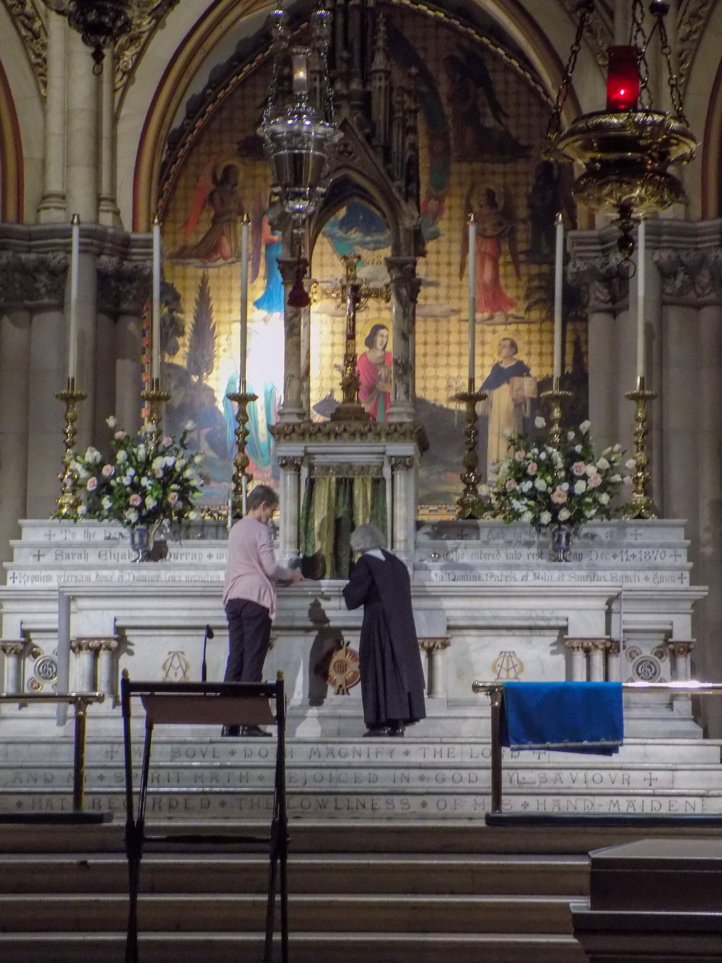 Sr. Laura Katharine and MaryJane Boland changing the fair linen before the Sunday Vigil Mass on Saturday evening.