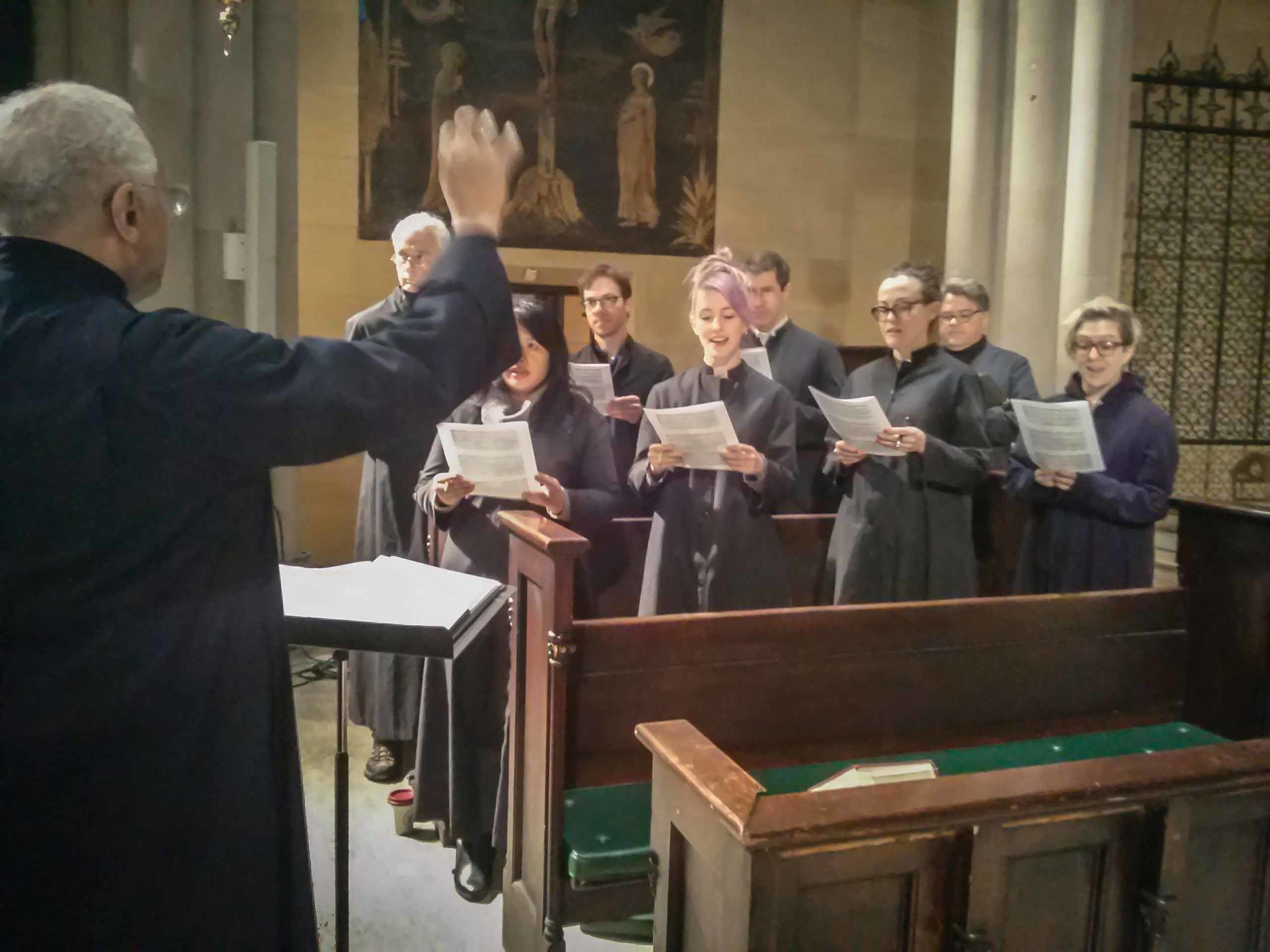 The choir rehearses in the chancel between the Said Masses on Sunday morning during Lent.