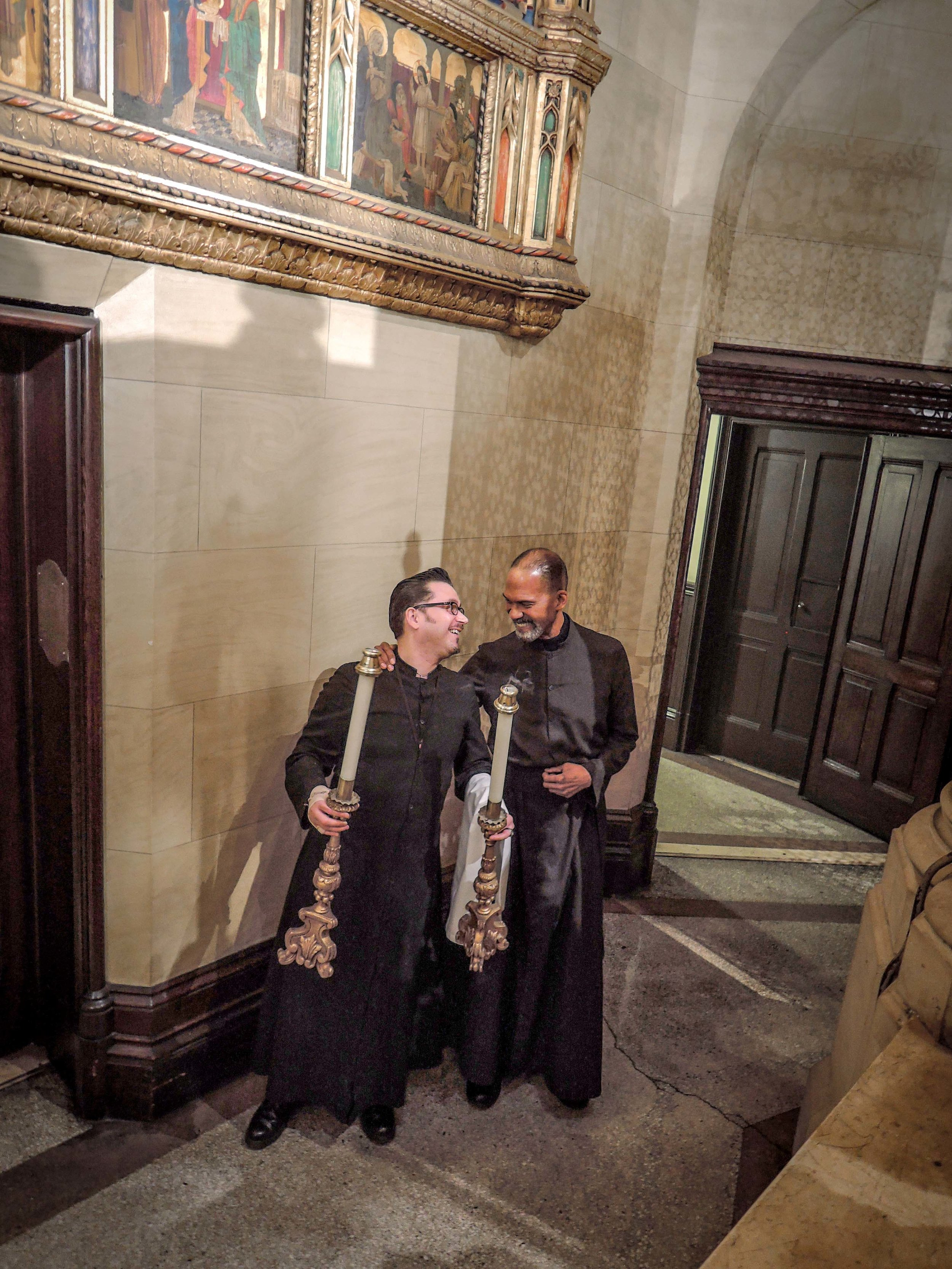 Acolytes Ricardo Mirando (left) and Charles Carson (right) prepare   for Solemn Mass last   Sunday.