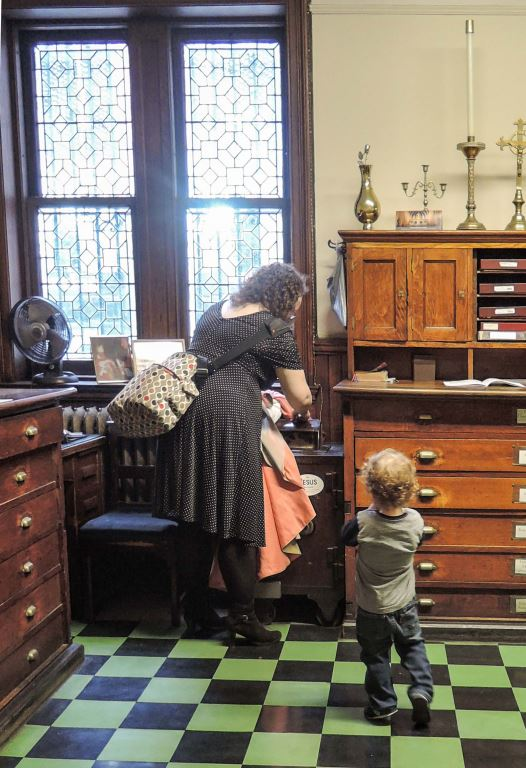 Mother and child in the sacristy between Masses on the Fourth Sunday in Lent.