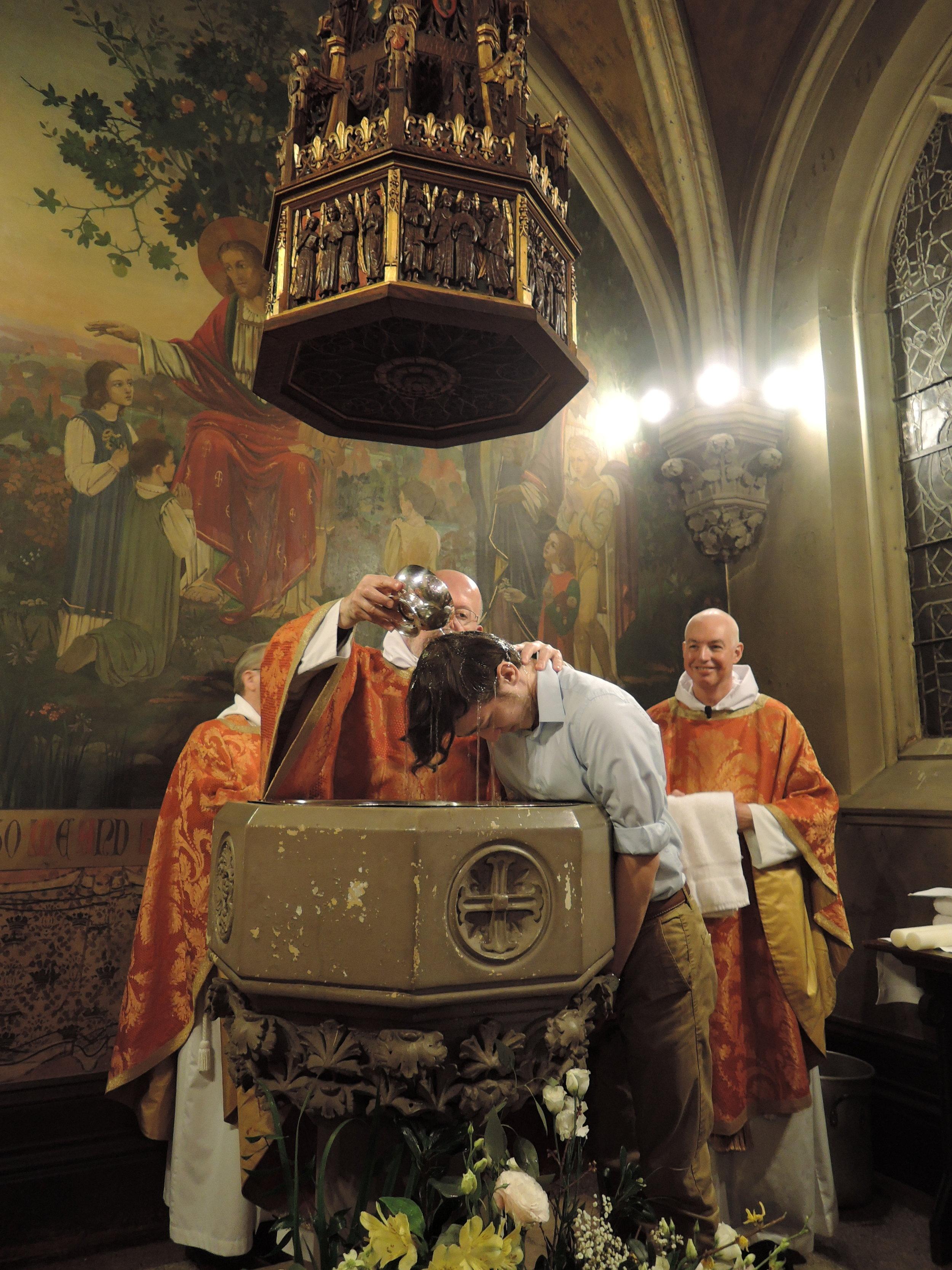 Father Smith baptizes Rami.