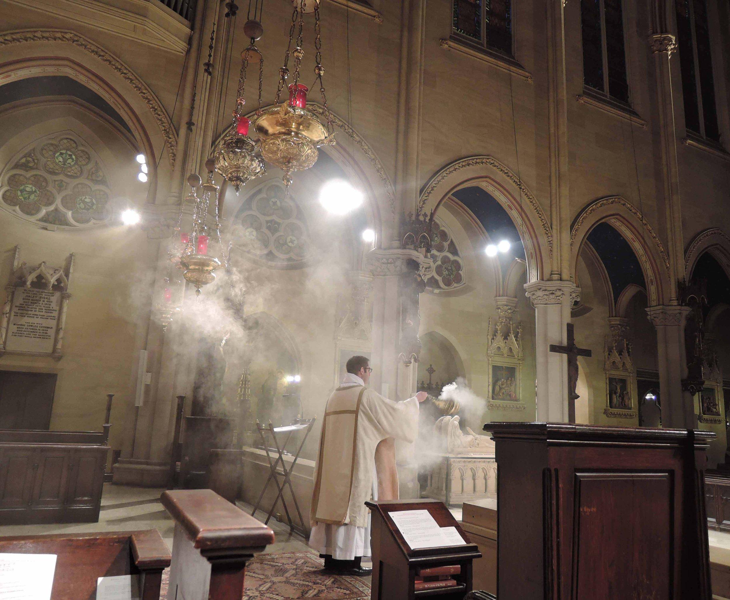 Deacon Matt Jacobson censes the congregation.