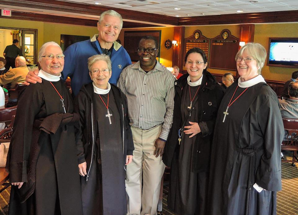 Some of the sisters with former New York Giants player Bart Oates (L) and Father Joseph Ngijoe of the diocese of the Camaroon of the Church of the Province of West Africa.
