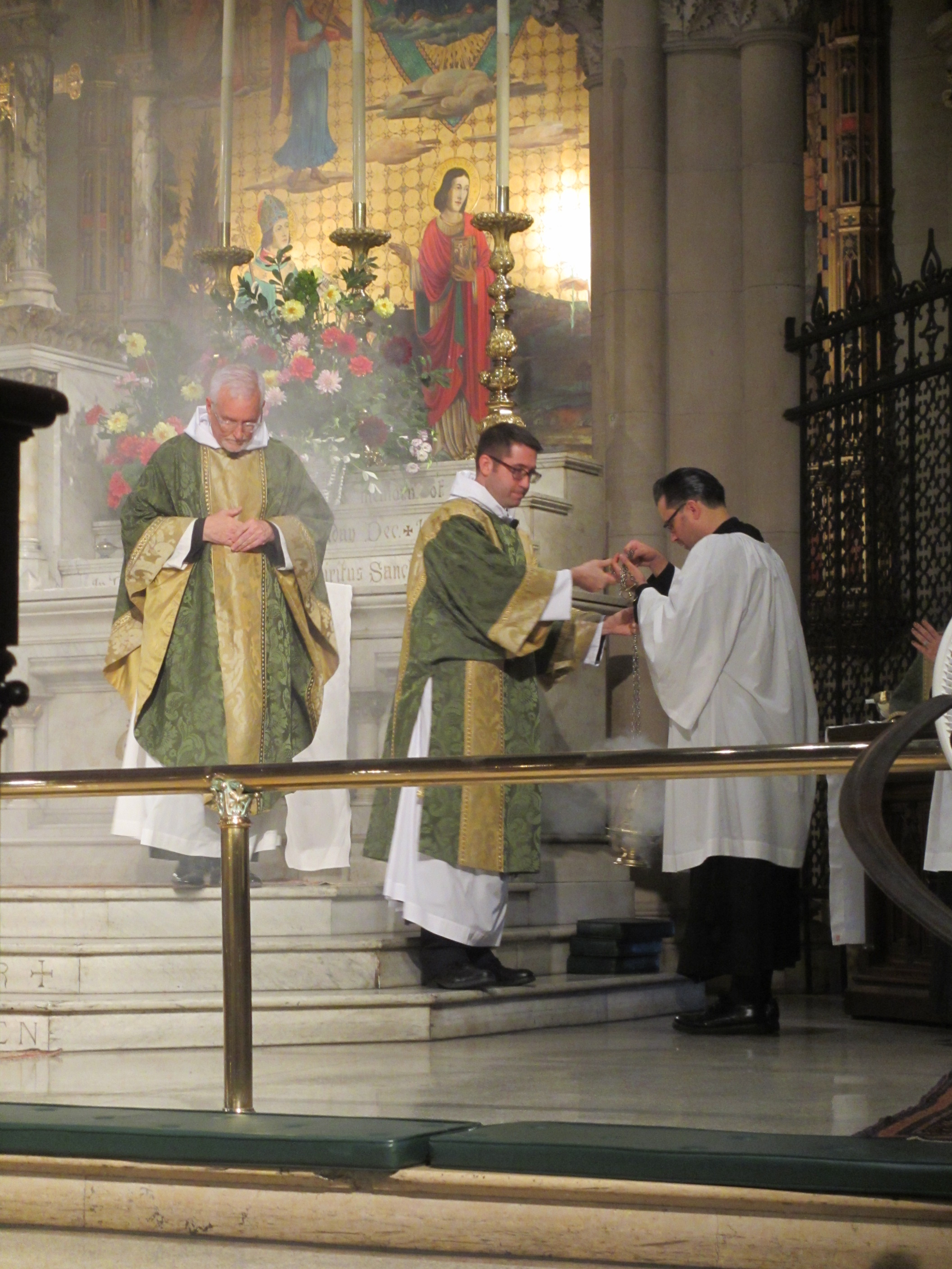 Having censed the altar, Father Pace prepares to chant the Collect of the Day.