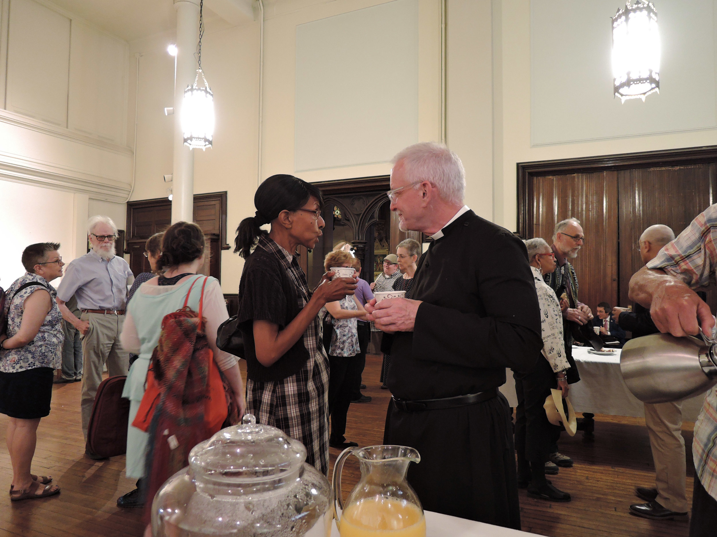 Sharon Stewart chats with Father Pace at Coffee Hour.