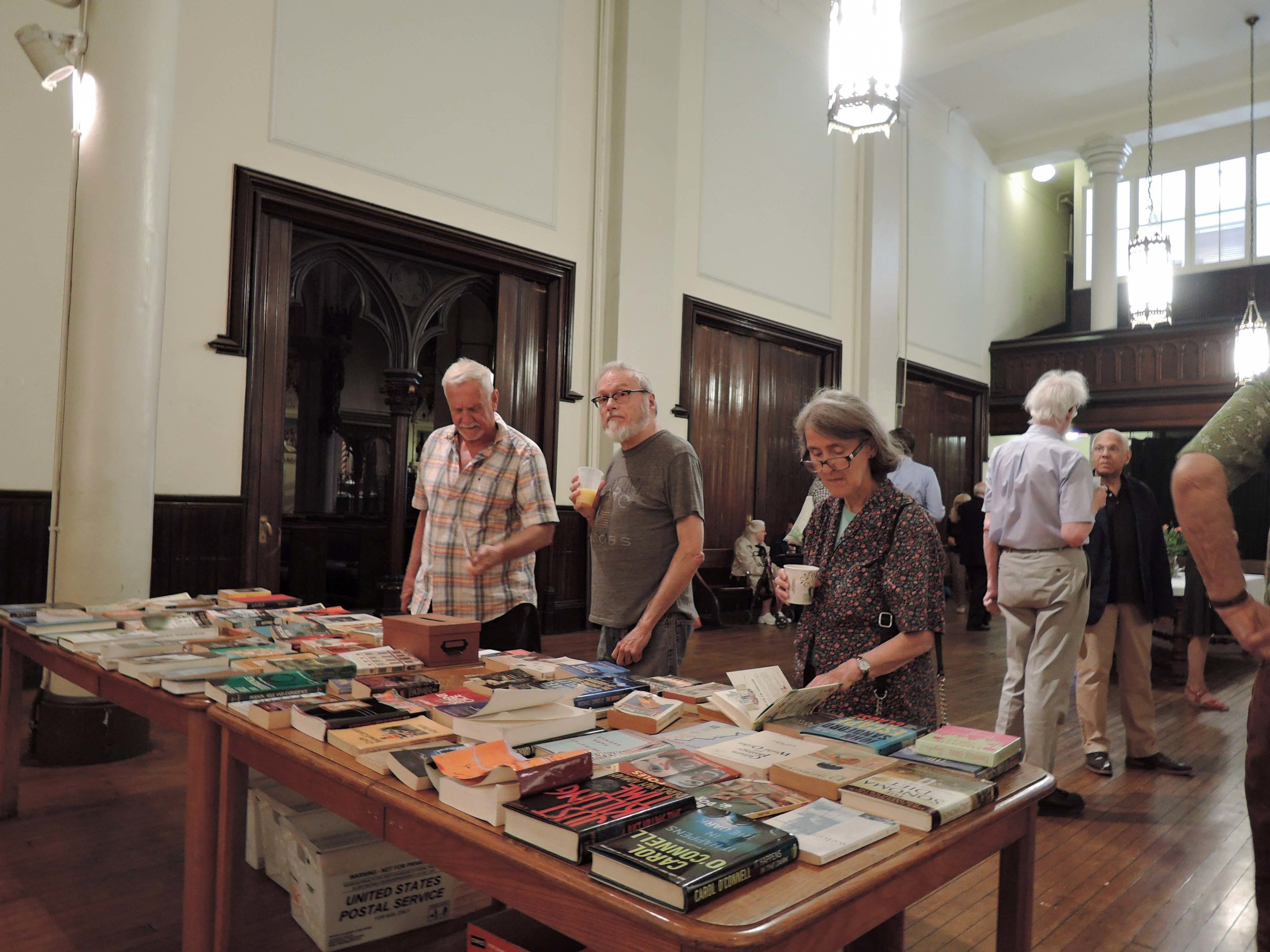 Browsing at the Book Sale Table:     Charlie Walsh, Rick Austill, and Stephanie Felshin