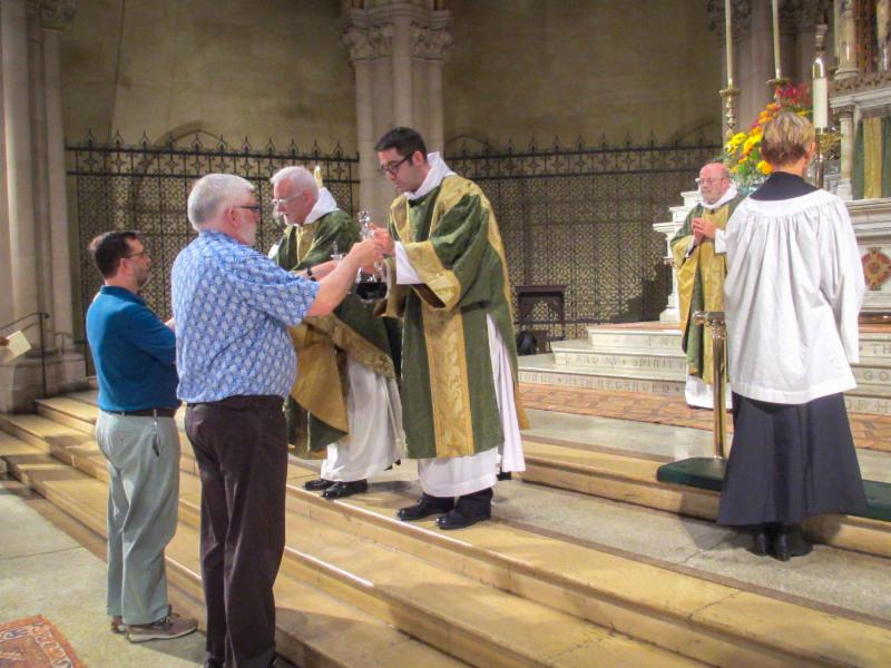 Father Pace and Deacon, soon to be Father,     Matthew Jacobson receive the gifts