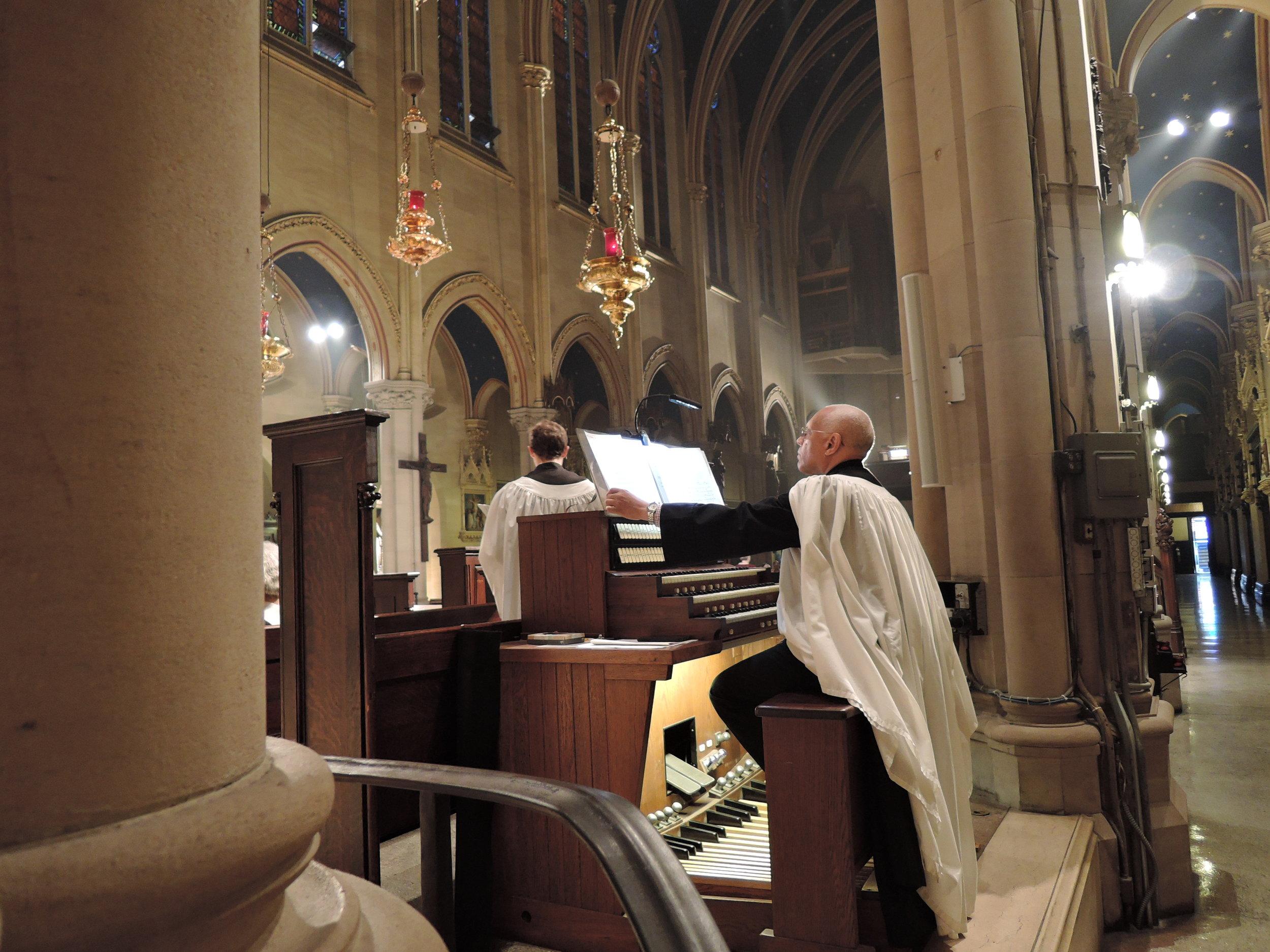 Dr. David Hurd at the chancel organ console.