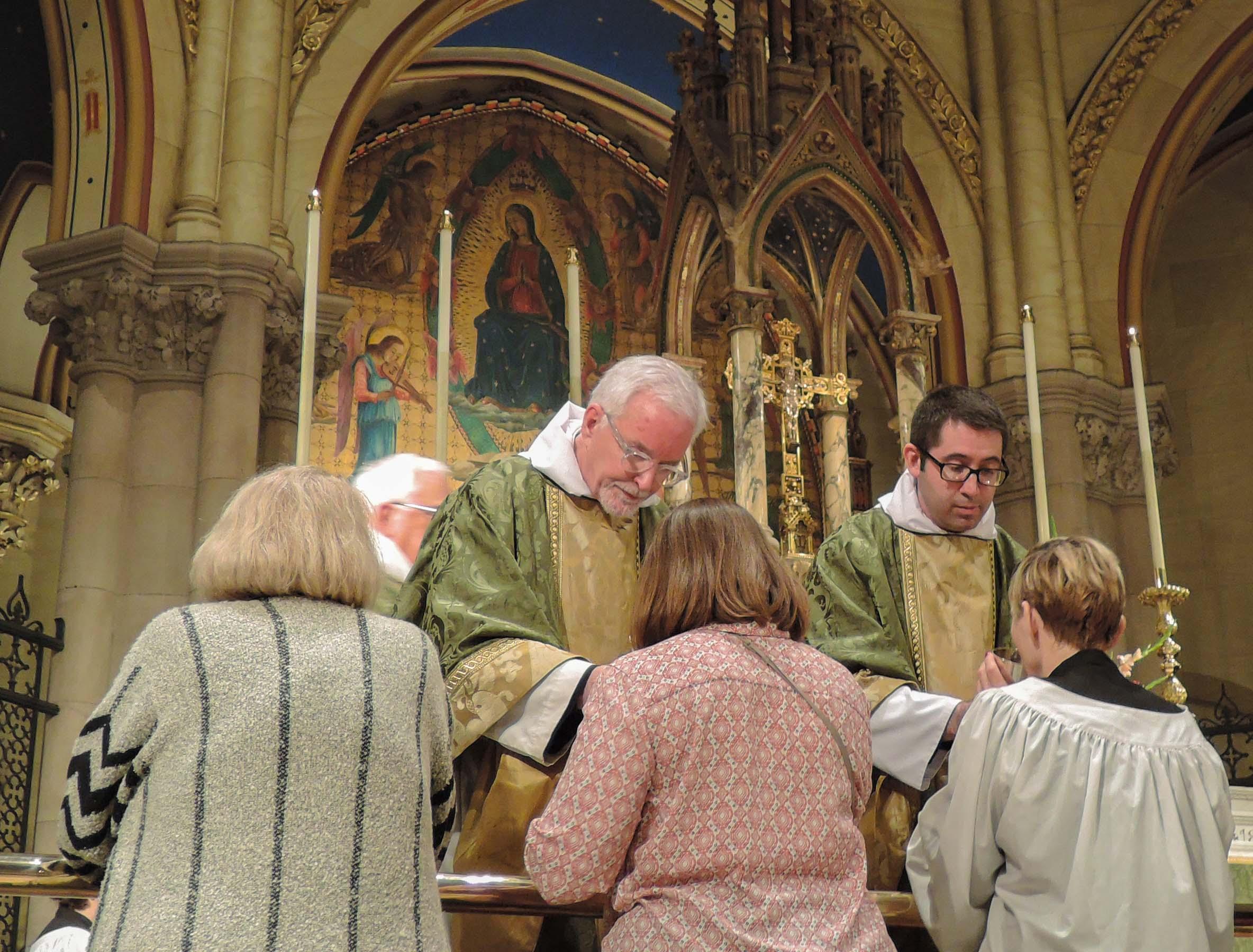The Ministration of Communion, Fr. Jim Pace (L), Fr. Matt Jacobson