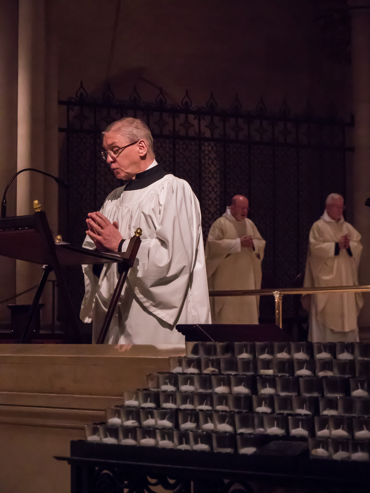 The Prayers of the People: When the deacon is away, a layperson (on Christ the King, Dr. Leroy Sharer) sings the prayers at Solemn Mass.  Photo by Ricardo Gomez
