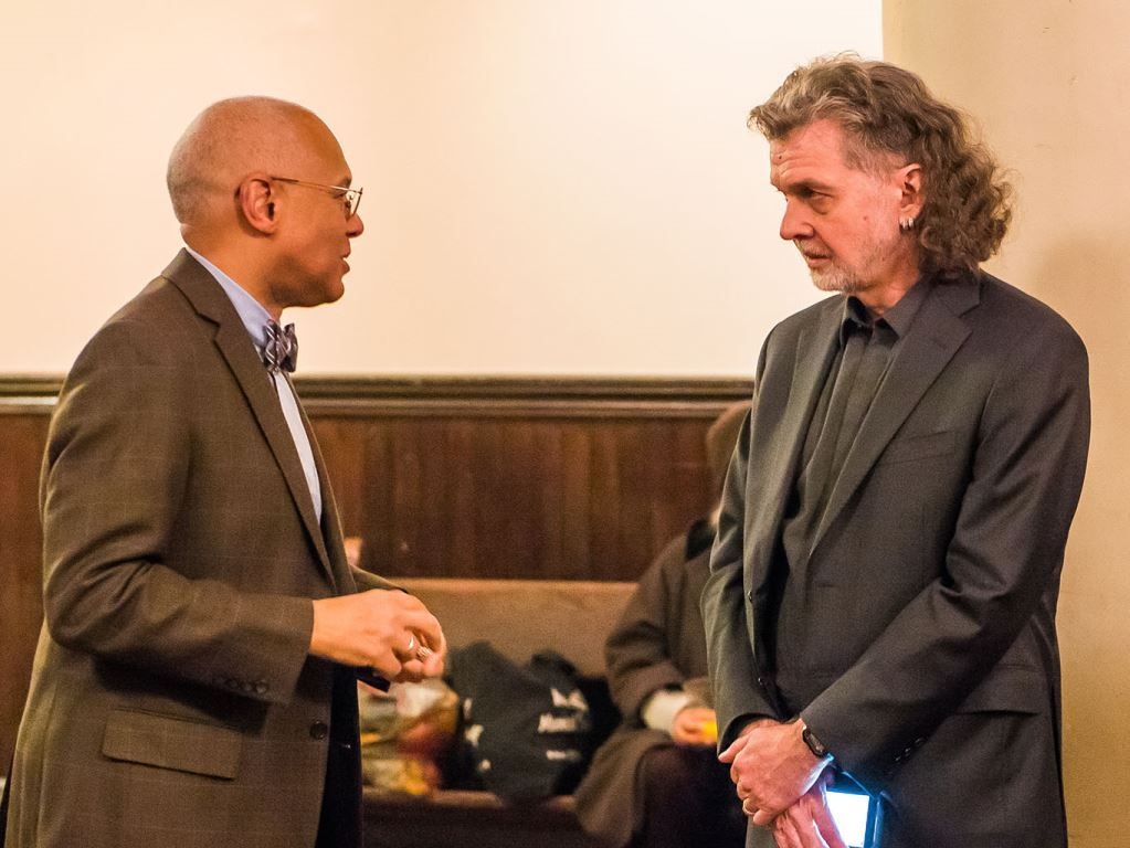 Dr. David Hurd speaking with composer Hayes Biggs, whose Mass for All Saints' was sung on December 3.  Photo by Ricardo Gomez