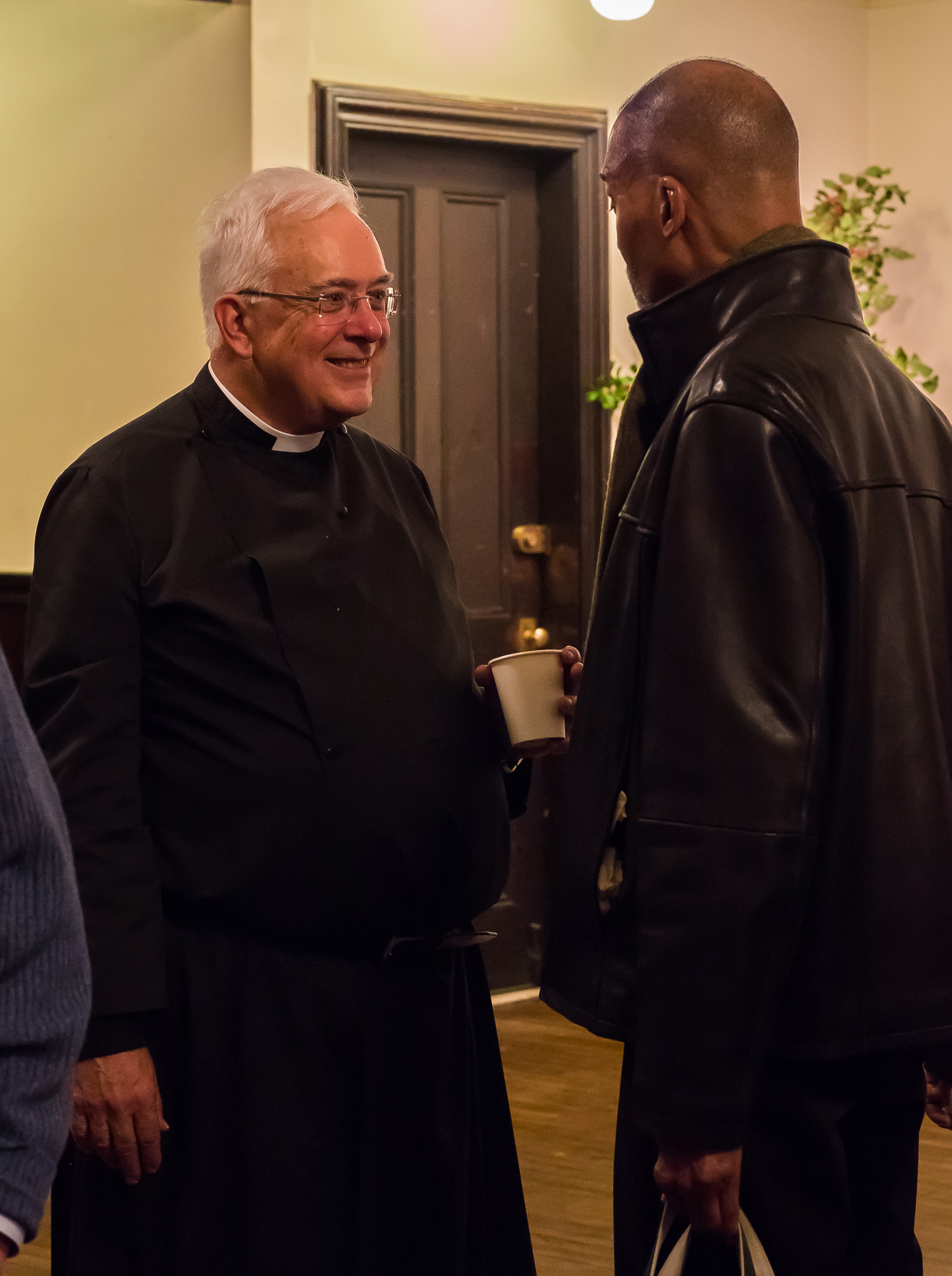 Father Pete Powell and Charles Carson at Coffee Hour after the Solemn Mass.     Photo by Ricardo Gomez