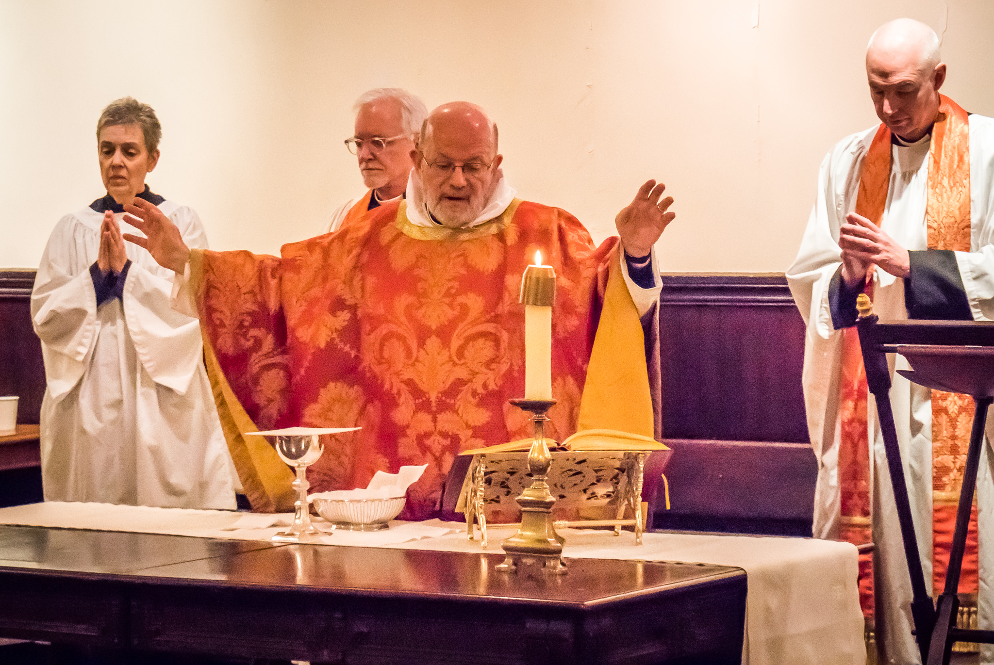 MaryJane Boland, Father Pace, and Father Smith at the Sung Mass for the Feast of the Holy Name on New Year's Day.  Photo by Ricardo Gomez