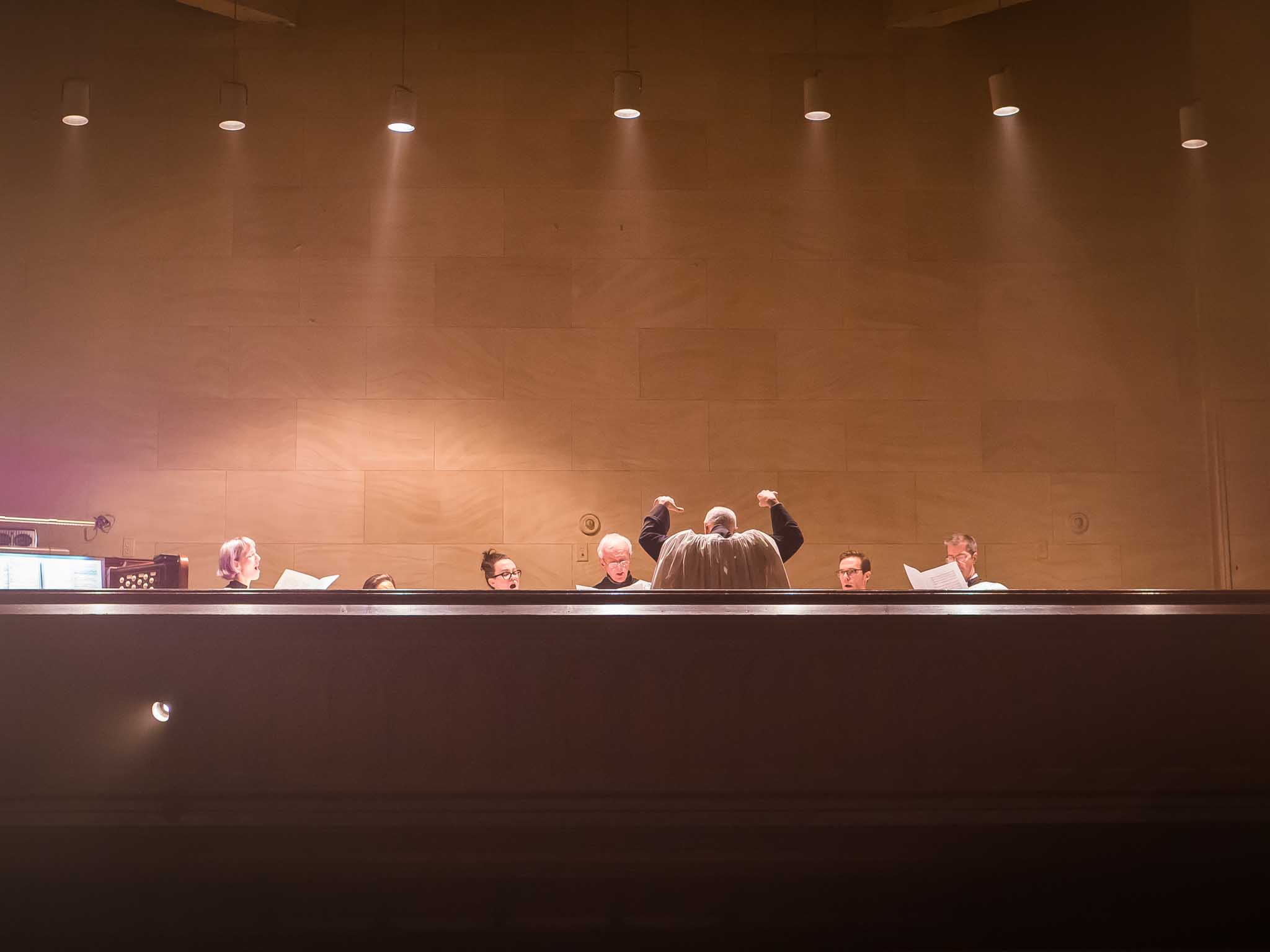 Dr. David Hurd conducts the choir on January 7.  Photo by Ricardo Gomez