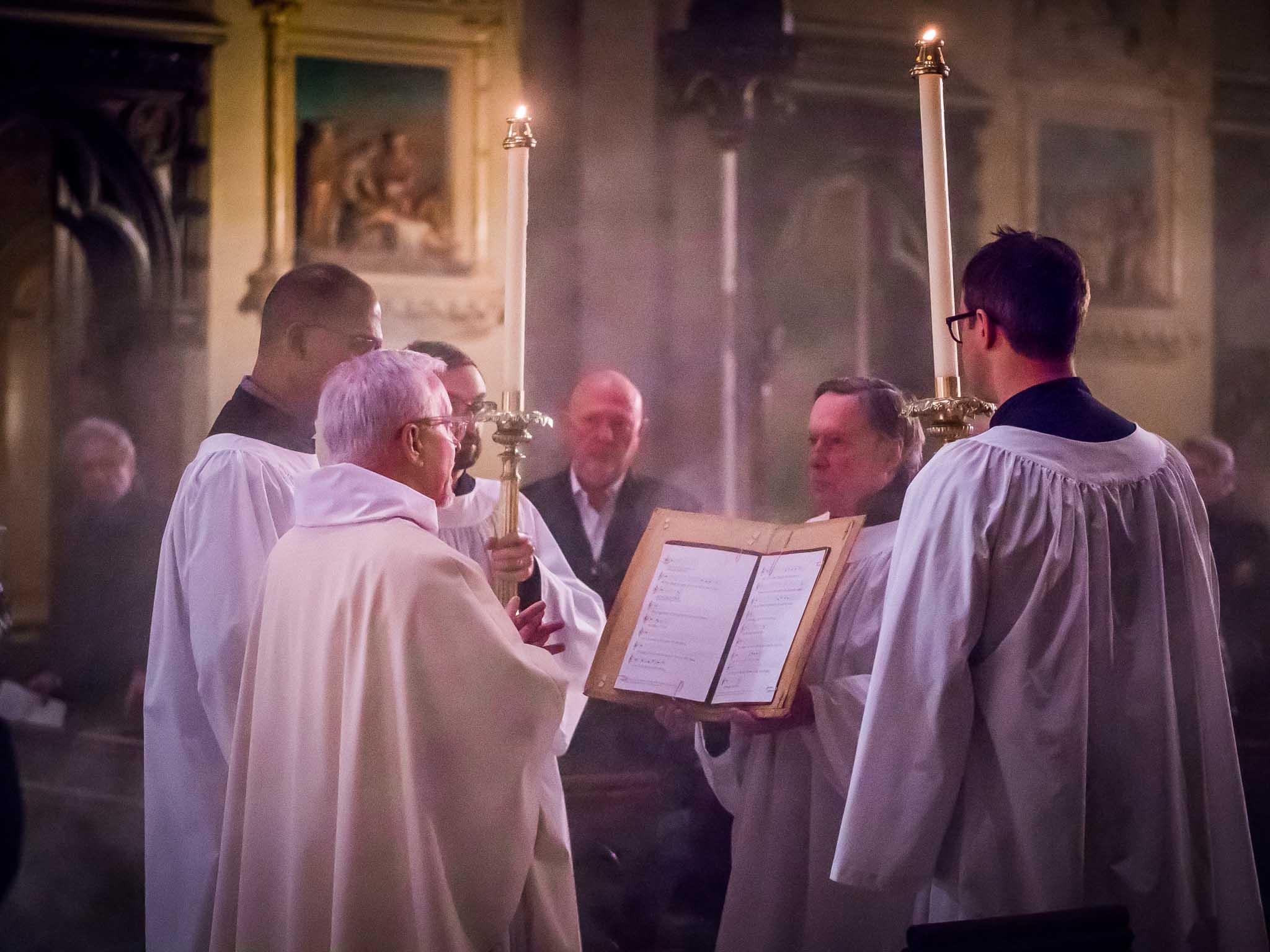 Father Jim Pace proclaims the gospel.  Photo by Ricardo Gomez