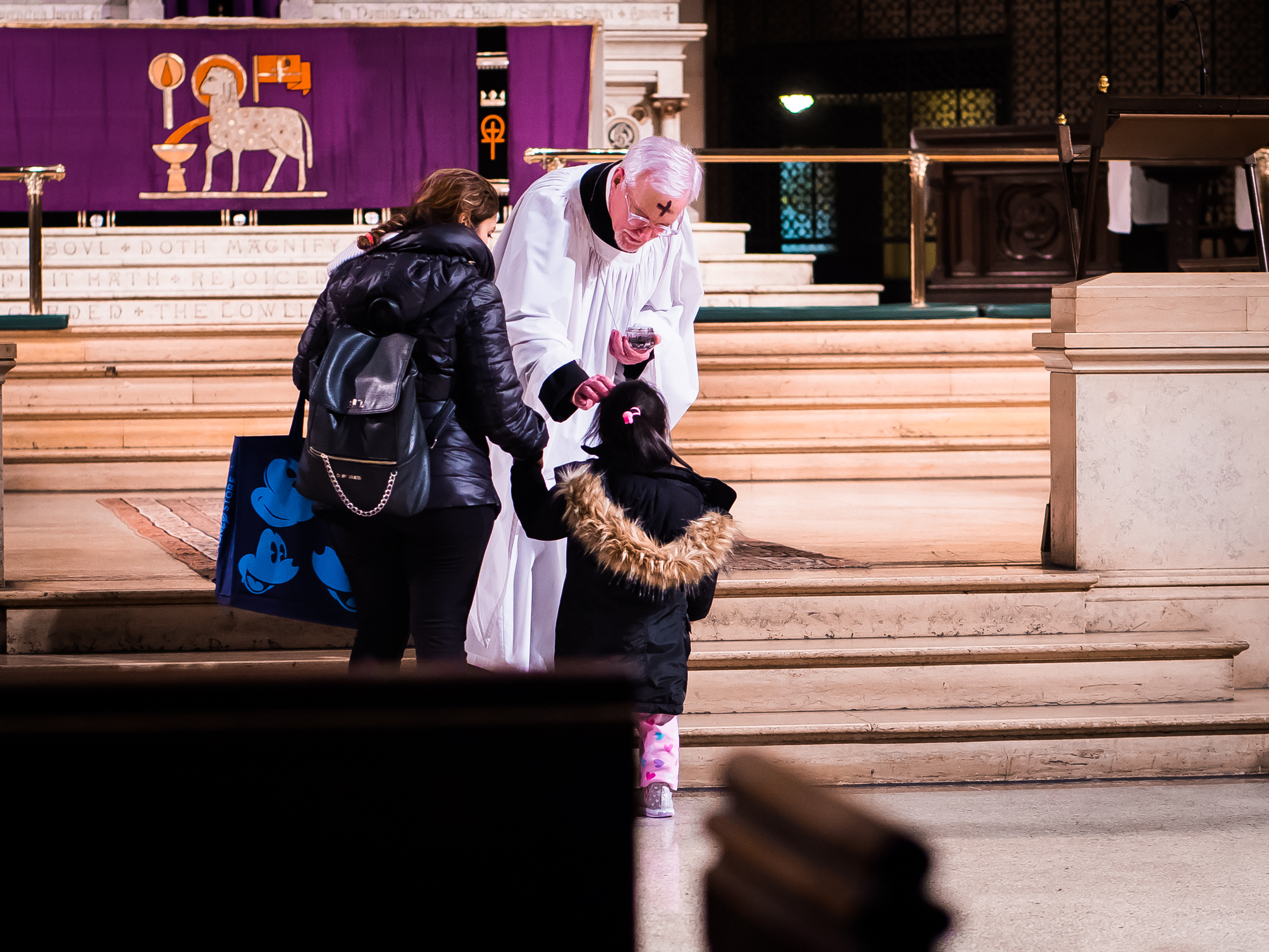 Father Pace was celebrant for the 7:00 AM Mass and returned later to assist with the imposition of ashes and to concelebrate the 6:00 PM Solemn Mass.  Photo by Ricardo Gomez