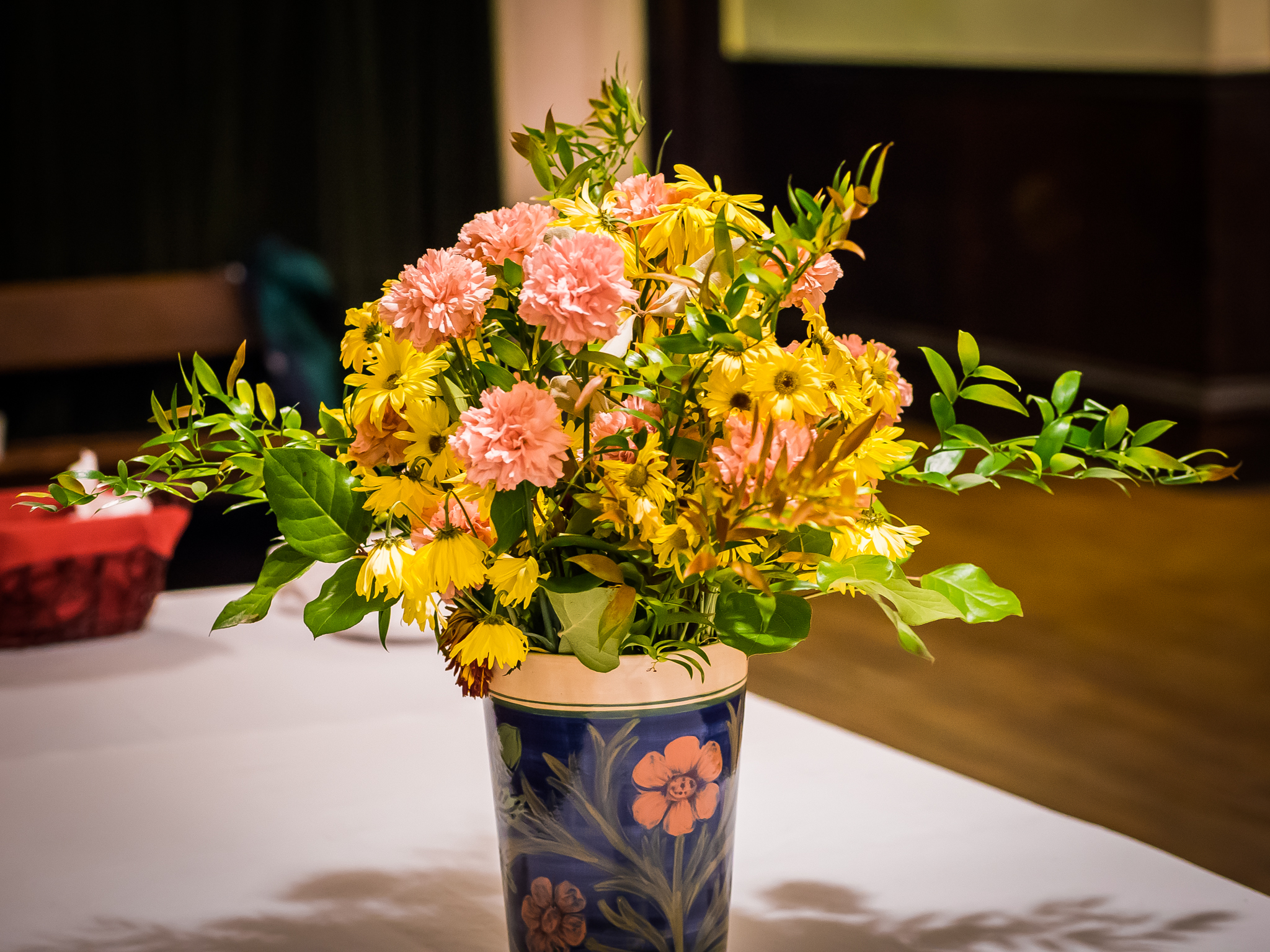Flowers on a table in the parish hall.  Photo by Ricardo Gomez