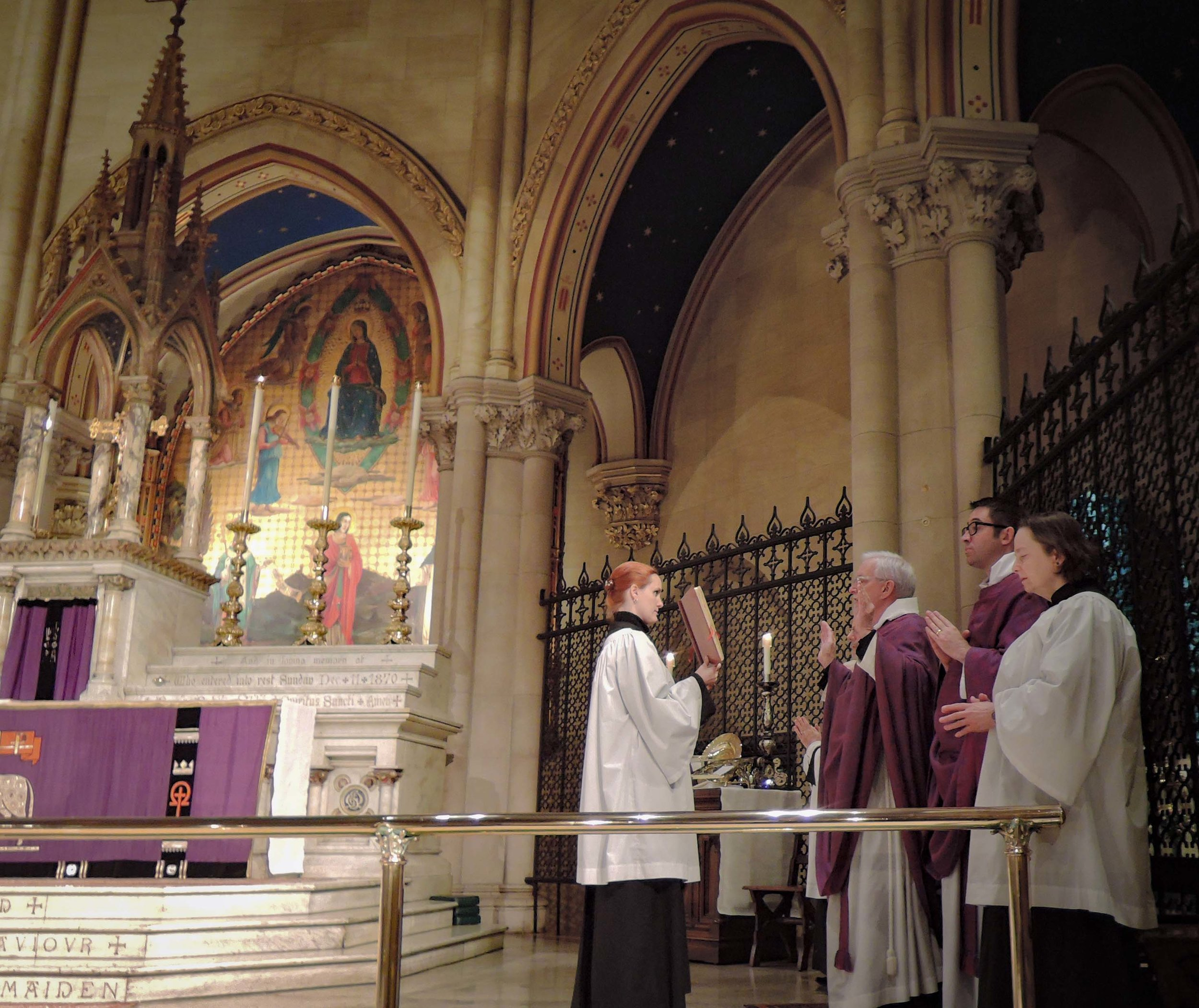 Father Jim Pace sings the collect of the day as Mass begins on Sunday, March 18.   Photo by Sr. Monica Clare, C.S.J.B.