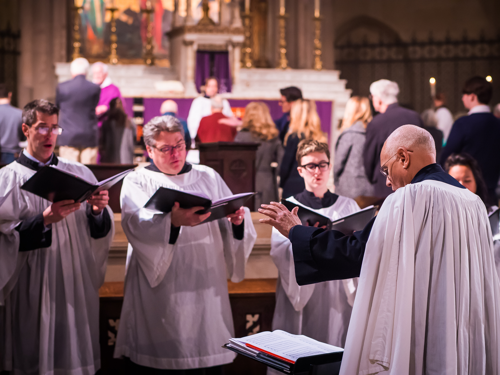 A motet is sung in front of the chancel during the ministration of Communion.   Photo by Ricardo Gomez