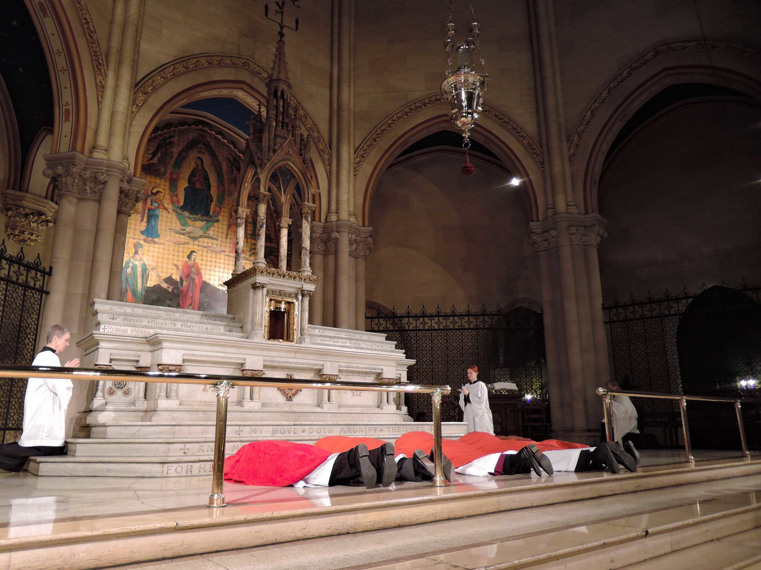 The Good Friday Liturgy begins with the clergy prostrate before the high altar.  Photo by Sr. Monica Clare, C.S.J.B.