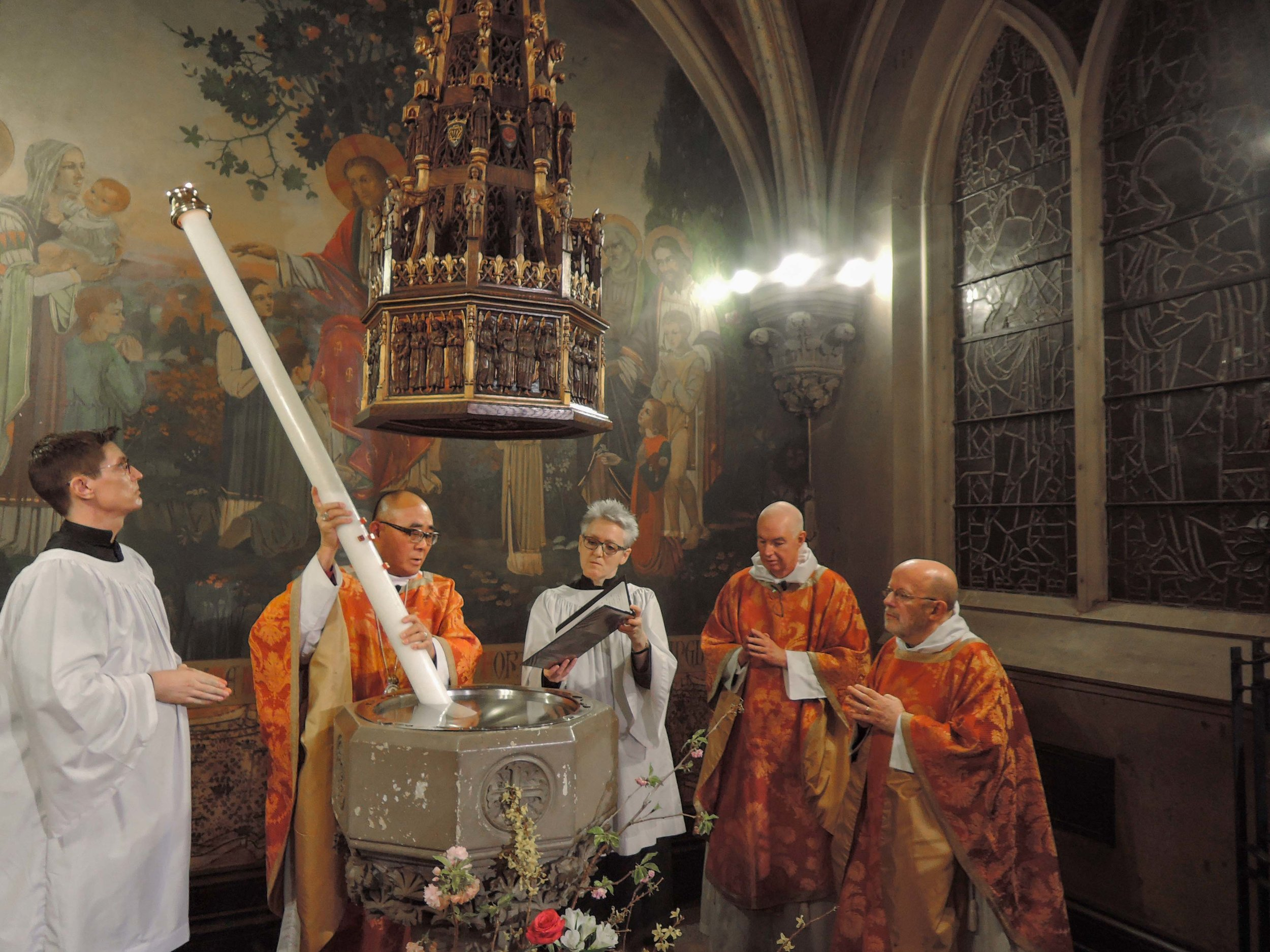 The Paschal Candle is plunged into the font during the Thanksgiving over the Water.  Photo by Sister Monica Clare, C.S.J.B.