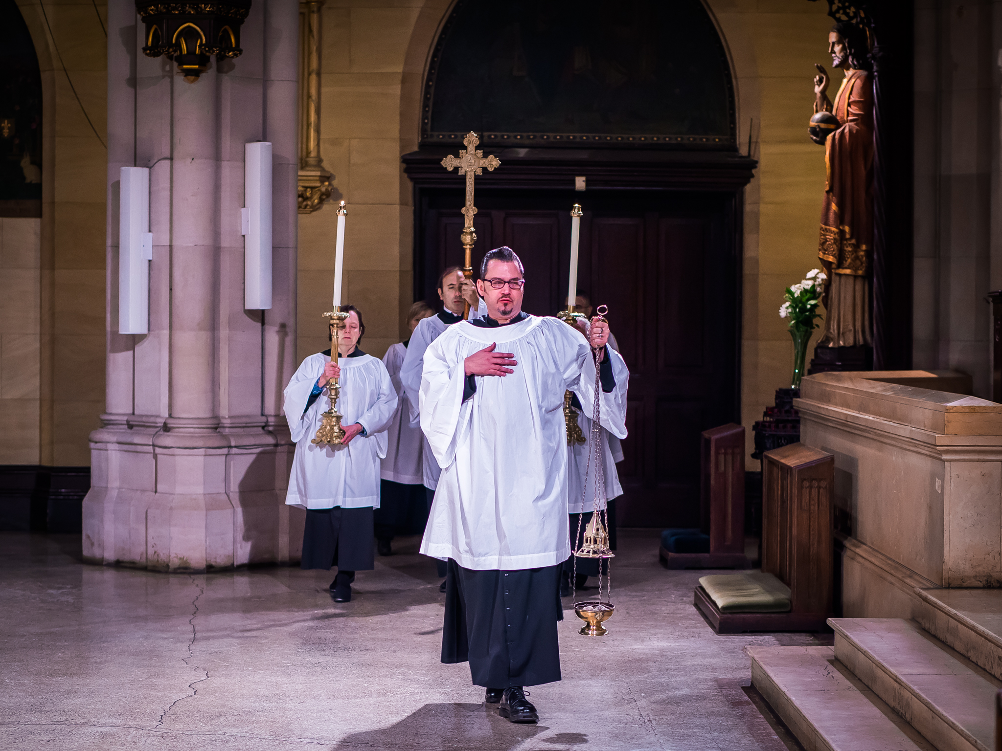 """The servers and clergy enter. The choir sings the traditional introit for this Sunday, """"Be joyful in God, all you lands, alleluia.""""  Photo by Ricardo Gomez"""