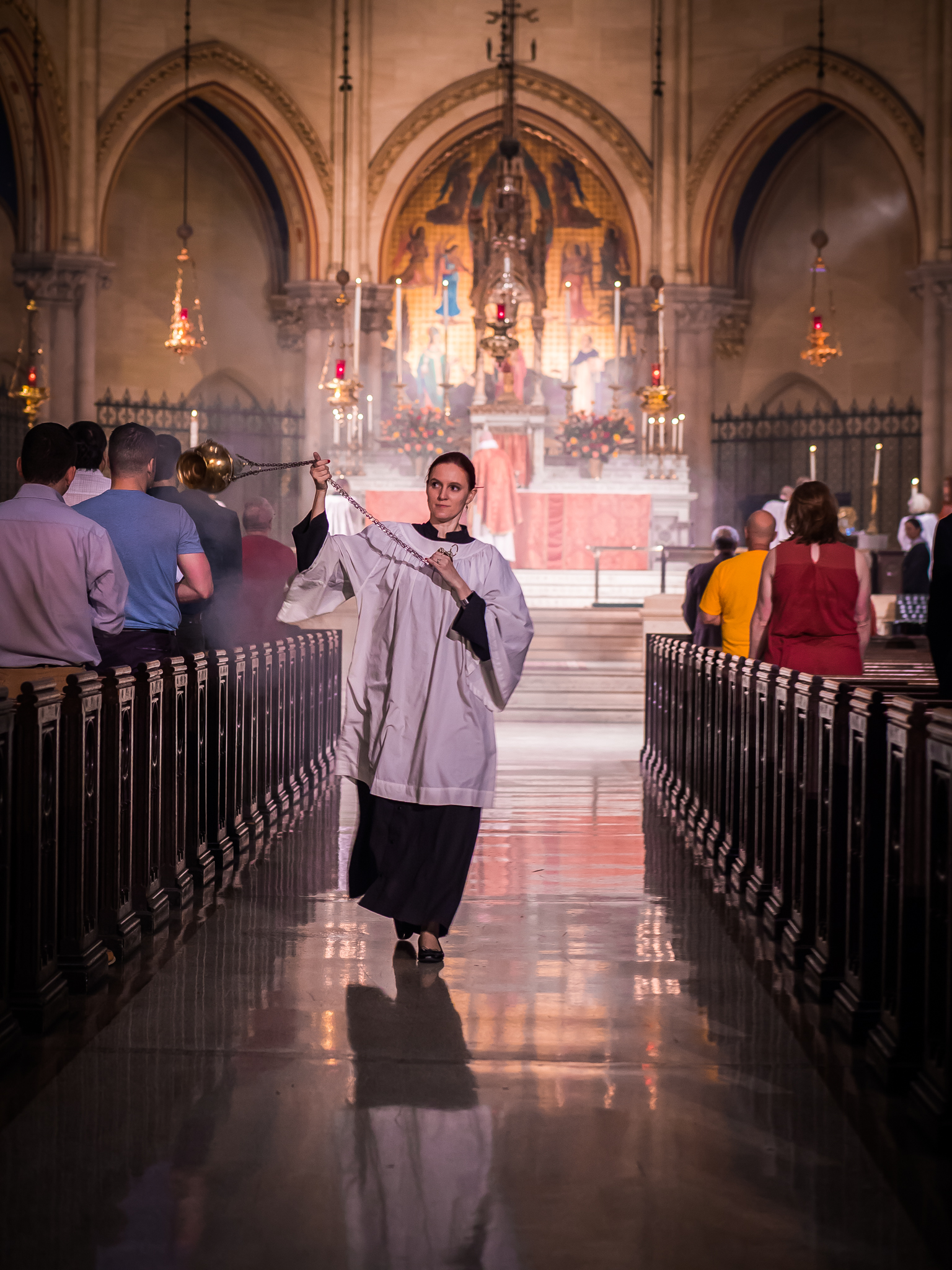 Thurifer J. Grace Mudd censes the people on the Day of Pentecost.  Photo by Ricardo Gomez