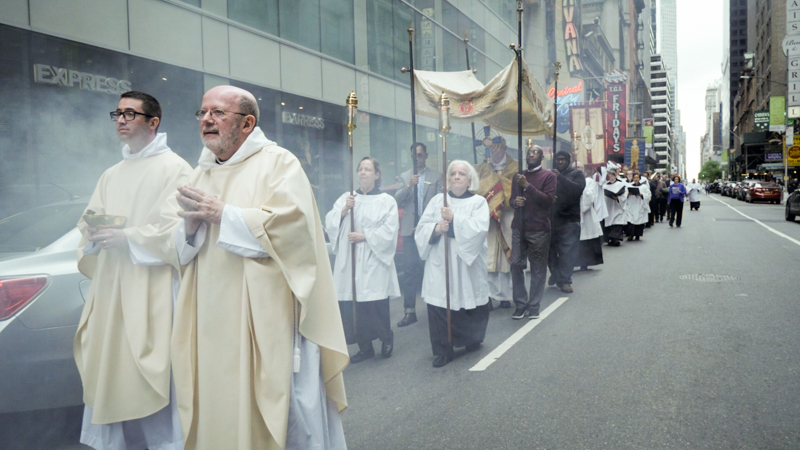 The assisting clergy, Fr. Matt Jacobson (L) and Fr. Jay Smith, follow the thurifers.  Photo by Ricardo Gomez