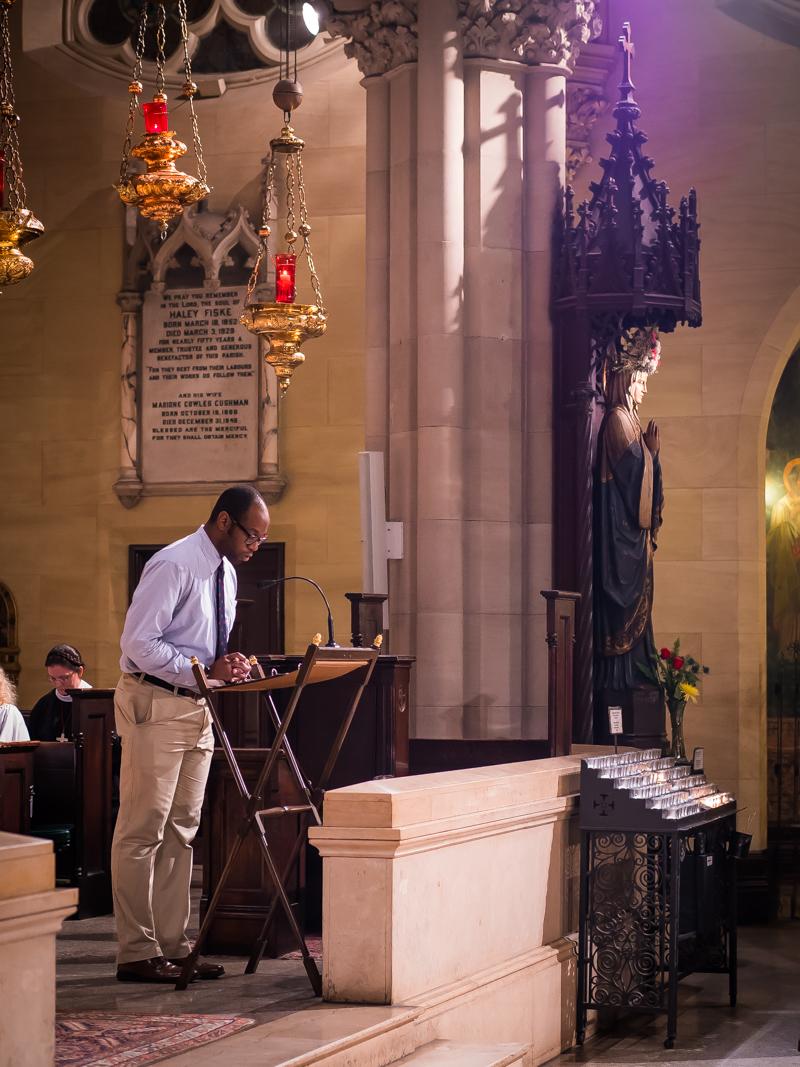 Dr. Daniel Okobi was lector.   Photo by Ricardo Gomez