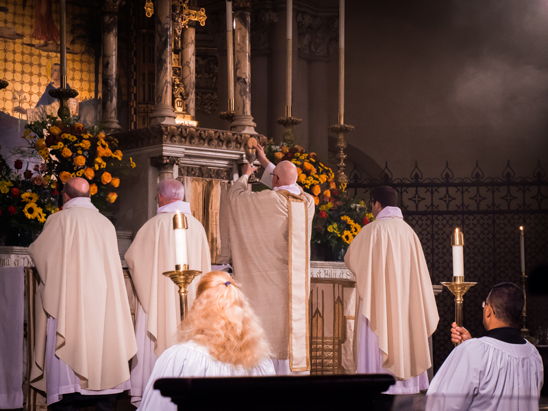 """The Bread and Cup are elevated during the final petition of the Eucharistic Prayer until the people have completed the prayer with their """"Amen.""""  Photo by Ricardo Gomez"""