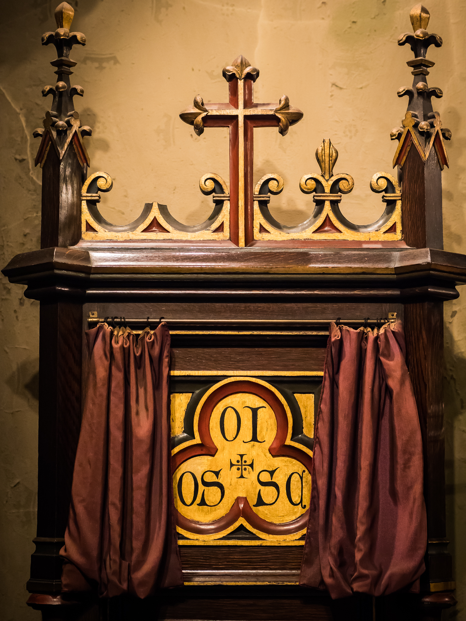 The aumbry in the baptistery where the Oil of the Sick and Chrism are kept. The veil was opened for the taking of this picture.  Photo by Ricardo Gomez