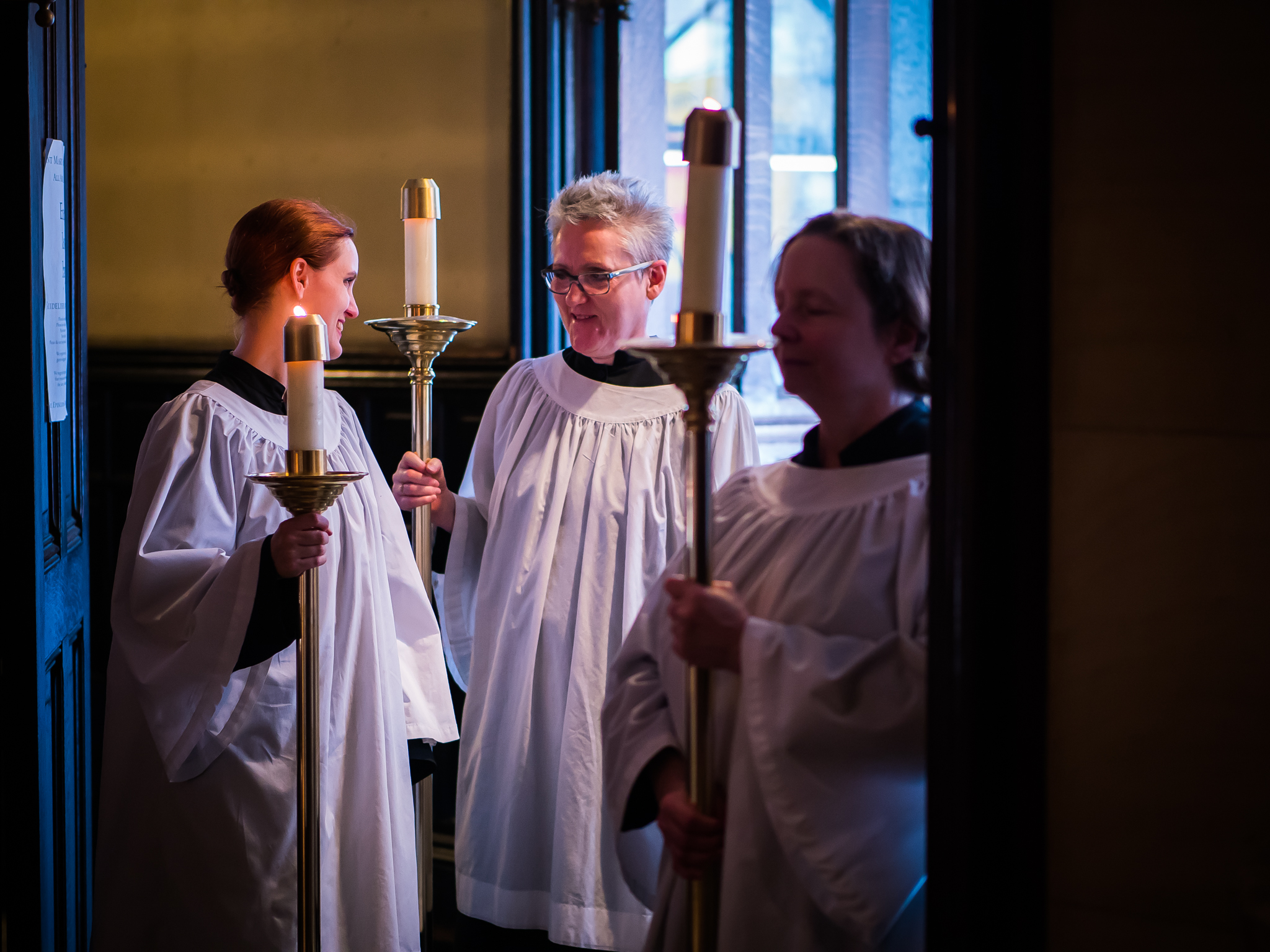 Behind the scenes: Grace Mudd (L), Marie Rosseels, and Marie Postelwate waiting for the procession of gifts to begin.  Photo by Ricardo Gomez