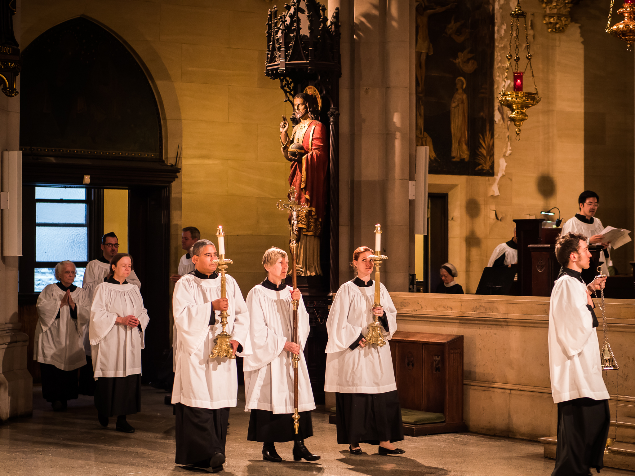 """The Entrance Procession. Cantor Jonathan May is singing the introit. Incense is not offered during the entrance unless a bishop is celebrant. Incense will be offered during the singing of """"Glory to God in the highest.""""  Photo by Ricardo Gomez"""