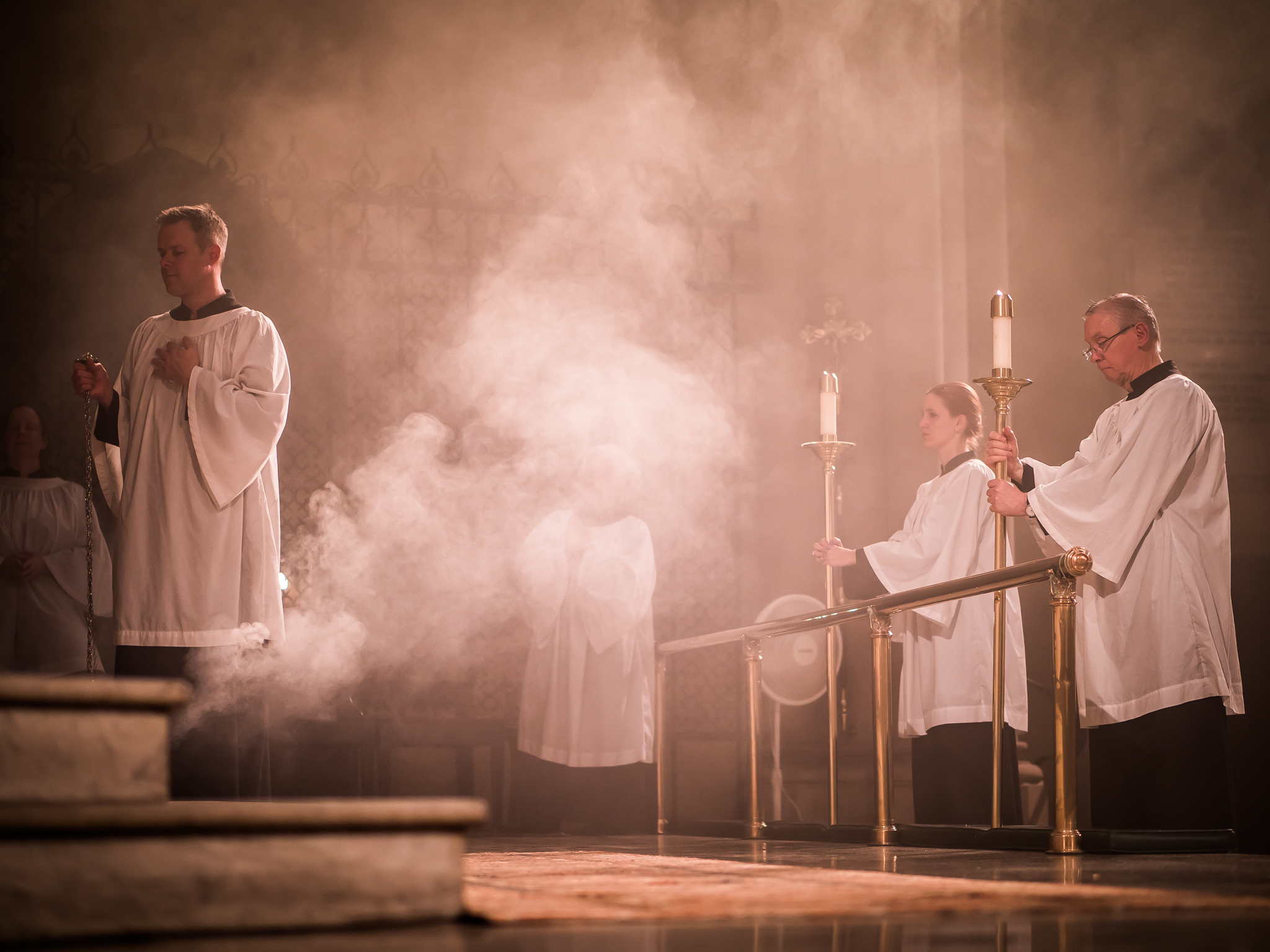 Clark Mitchell (L) was thurifer for the Solemn Mass on August 15.   Photo by Ricardo Gomez
