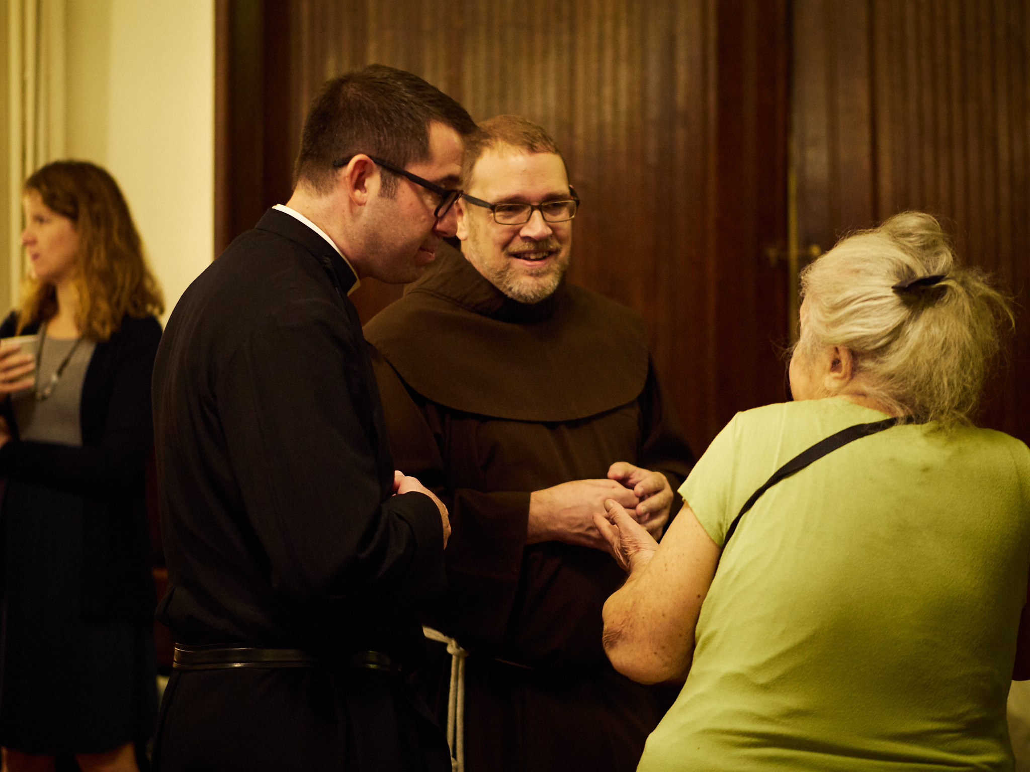 At coffee hour: Fr. Matt Jacobson (L) and Br. Damien Joseph, S.S.F, greet members of the congregation.   Photo by Ricardo Gomez