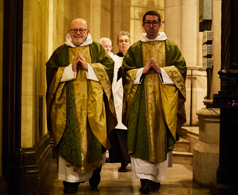 The entrance to Solemn Mass on Sunday, October 7, 2018. Father Jay Smith (L) and Father Matt Jacobson, followed by MaryJane Boland and Father Jim Pace.   Photo by Ricardo Gomez