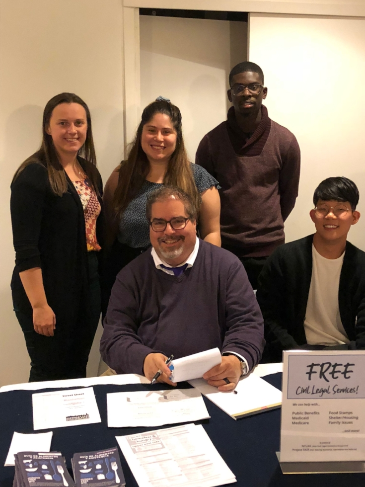 Chris Portelli (seated at center) and volunteers from the New York Legal Assistance Group provided much assistance at the Drop-in Day on Wednesday.  Photo: Brother Thomas, SSF