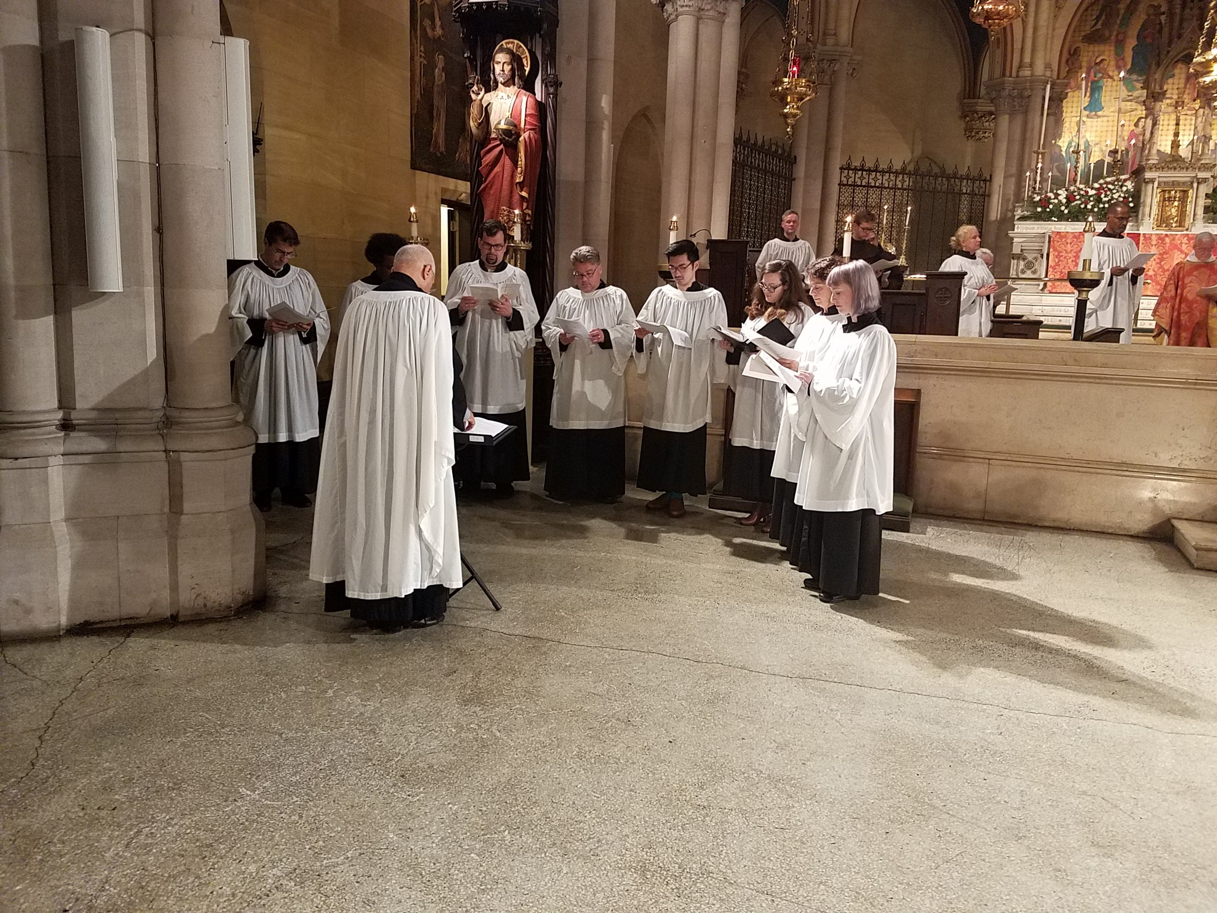 During the liturgy of Holy Baptism, the choir joins the congregation in the nave.   Photo by John Delves