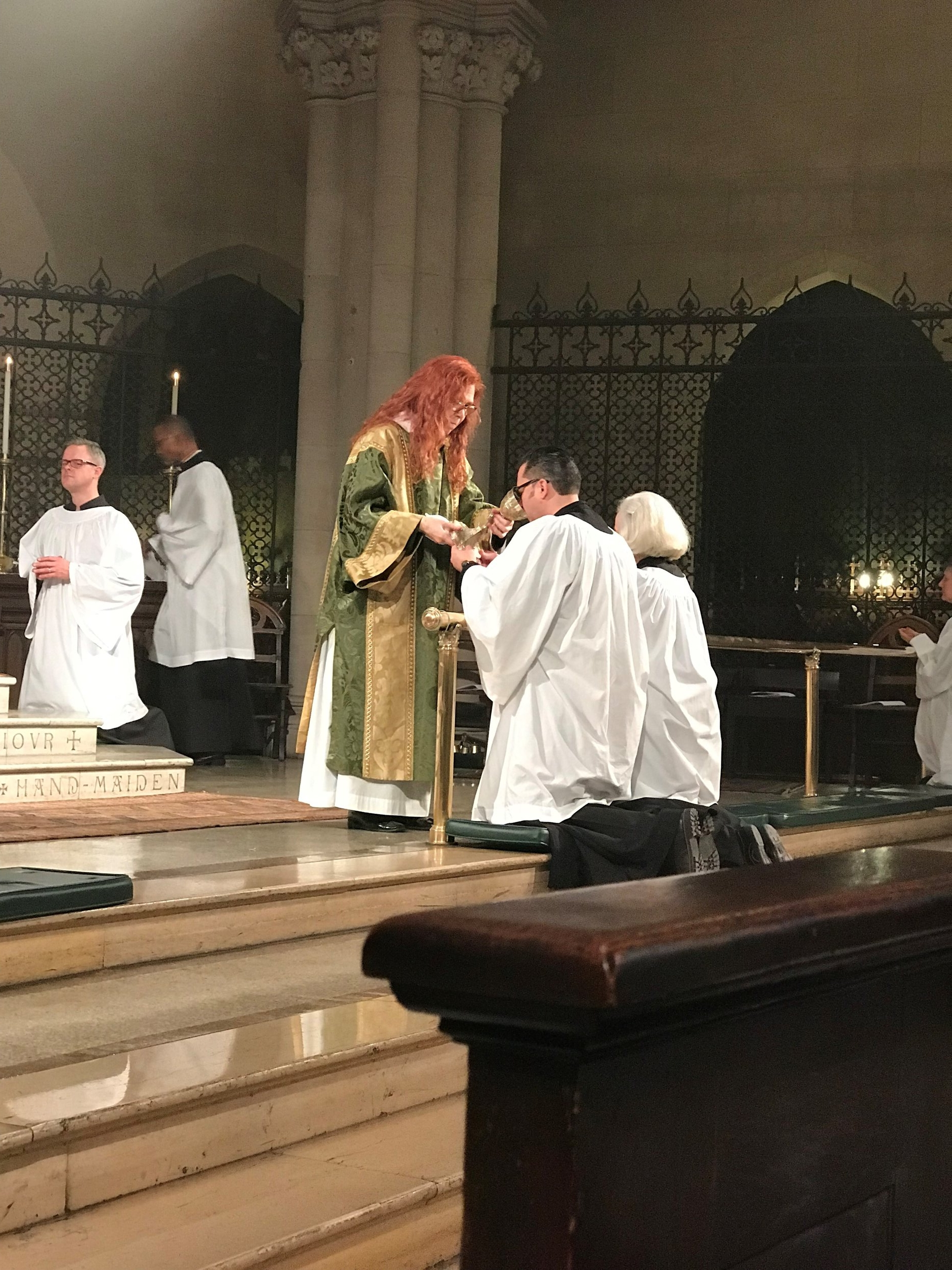 Deacon Rebecca Weiner Tompkins was with us. Servers seated in the chancel and ushers are among the last to receive Communion.   Photo by Br Damien SSF