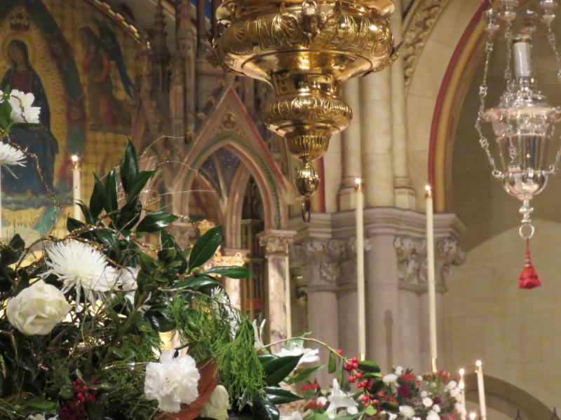 Many flowers adorn the chancel during the Twelve Days of Christmas.  Photo by Br. Damien Joseph SSF