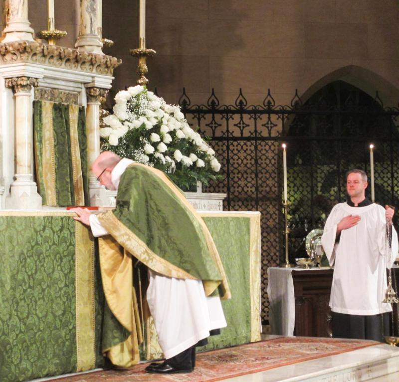 The celebrant, in this case Father Jay Smith, is the last of the clergy to reverence the altar at the beginning of the Solemn Mass. Photo from Sunday, February 3, 2019.  Photo by MaryJane Boland