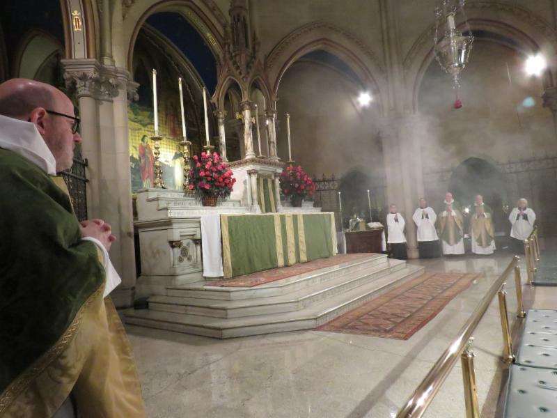 Incense lingers in the chancel as the choir finishes the opening song of praise.   Photo by Damien Joseph SSF