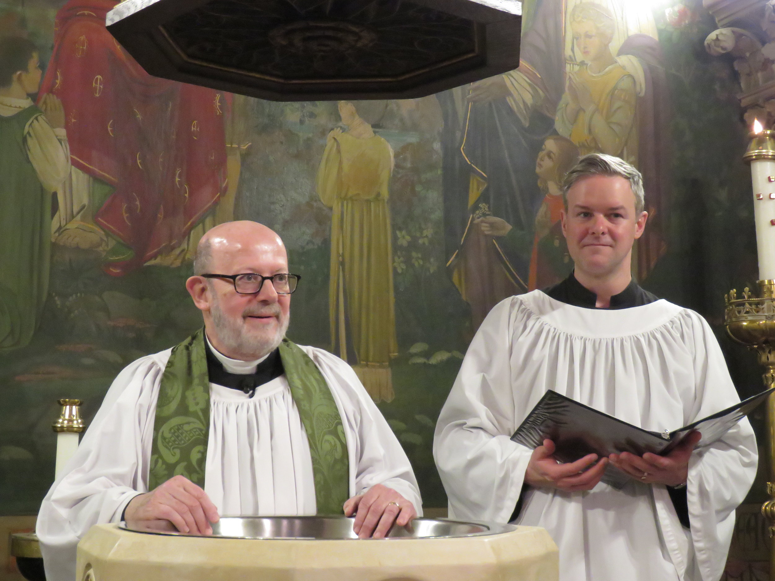 Father Jay Smith and Server Clark Mitchell as the baptismal rite begins.  Photo by Damien Joseph SSF