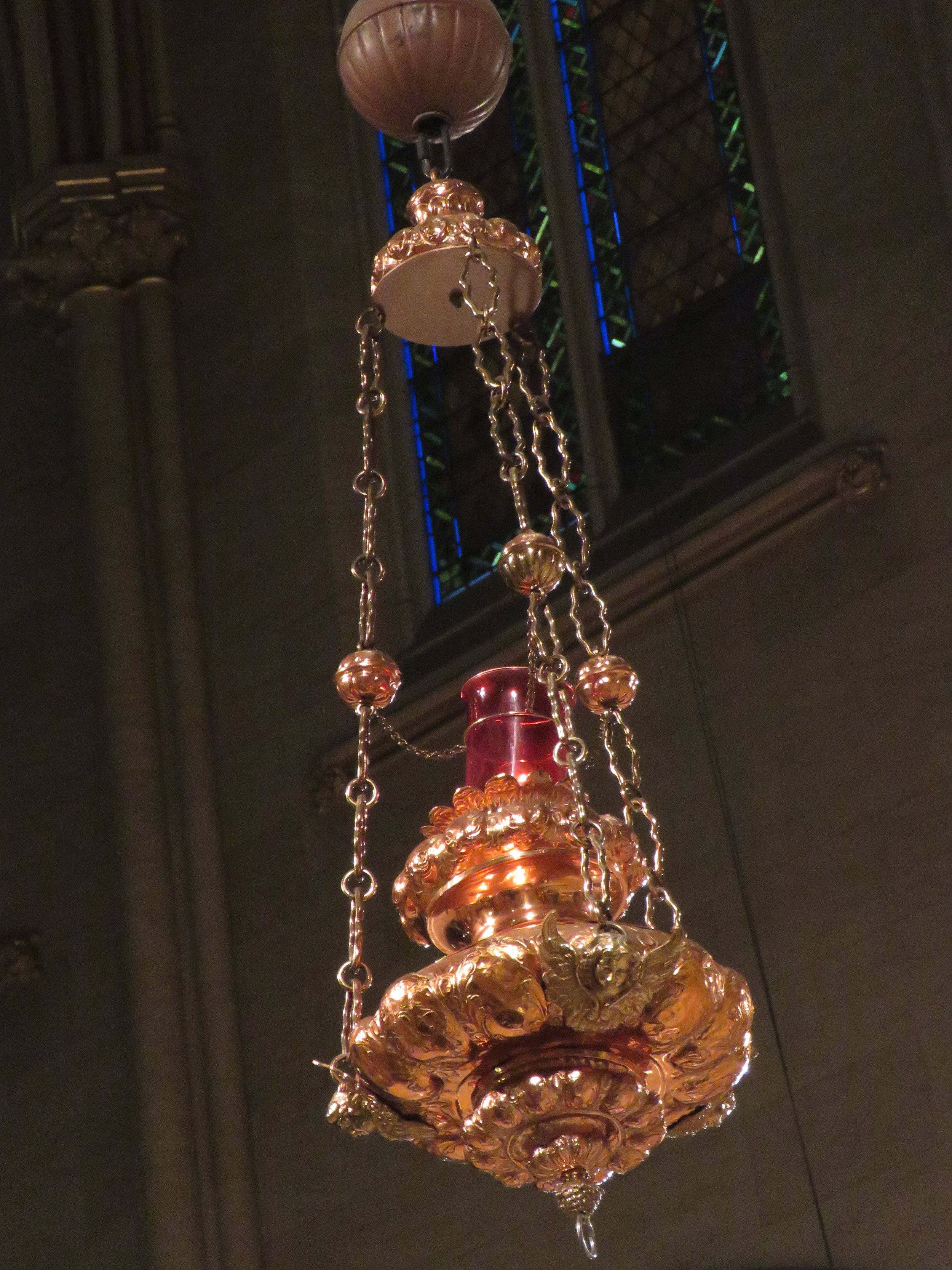 Three of the seven hanging lamps at the entrance to the chancel and the silver lamp that hangs before the altar will be removed for conservation in the near future. All of these lamps hung in the first church at 228 West 48th Street, that opened its doors on December 8, 1870. The second and present church opened on December 8, 1895.   Photo by Damien Joseph SSF