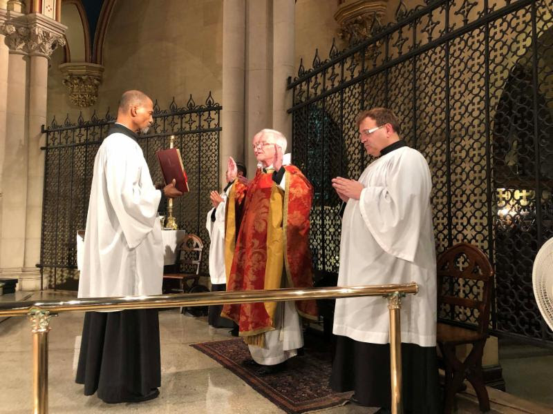 Father Jim Pace was celebrant and preacher. Charles Carson (L), Luis Reyes (hidden), and Eric Littlefield were among the servers.   Photo by Brendon Hunter