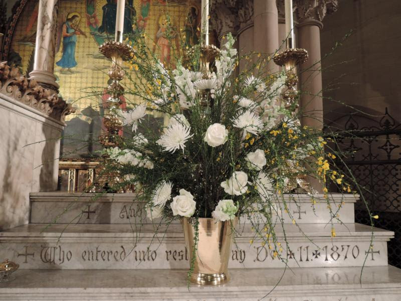 The flowers were given to the Glory of God and in memory of the Mitties McDonald DeChamplain, priest, by the parish clergy.     Photo: Clark Mitchell