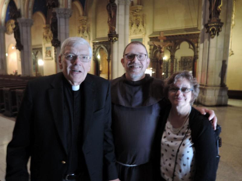 Brother Damien Joseph welcomed Father Ronald Jaynes and Mrs. Colleen Jaynes to Saint Mary's last Sunday. Photo: Stephen Gerth