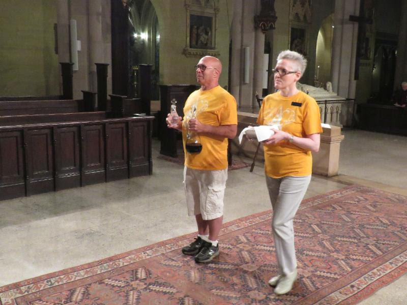 Darrell Lester and Marie Rosseels, wearing their AIDS Walk T-shirts, bring up the gifts of bread and wine. Photo: Brother Damien Joseph SSF
