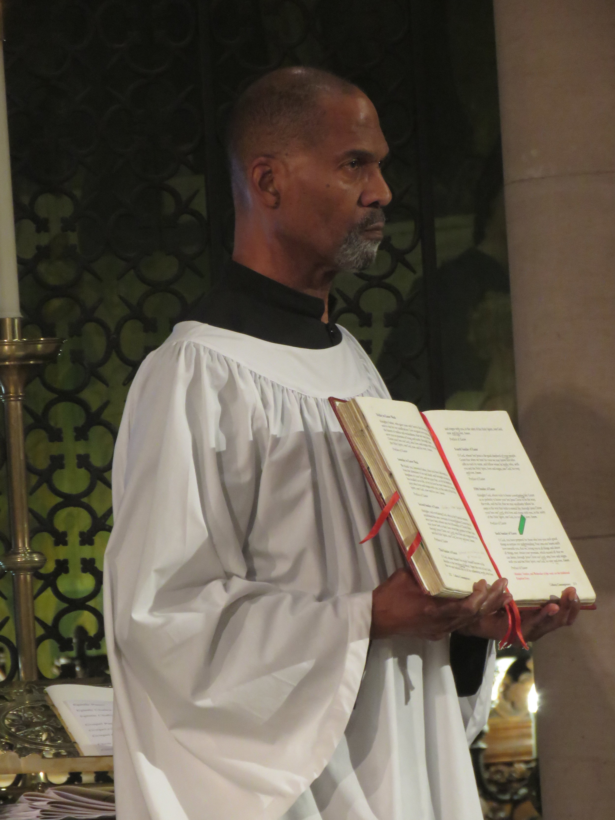 Charles Carson, who has served at the altar under three rectors, was master of ceremonies for the Mass on May 26.    Photo: Damien Joseph SSF