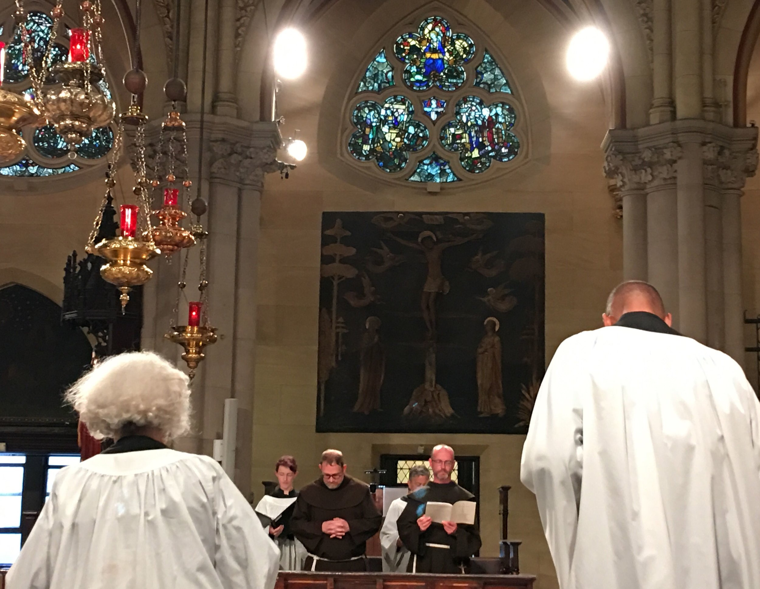 In choir, at the Solemn Mass: in the foreground, from the back (l. to r.): acolytes Julie Gillis and Charles Carson; in the background, facing front (l. to r.): Cantor Charlotte Mundy, Brother Damien Joseph SSF and Brother Desmond Alban SSF.   Photo:  Renée Pecquex